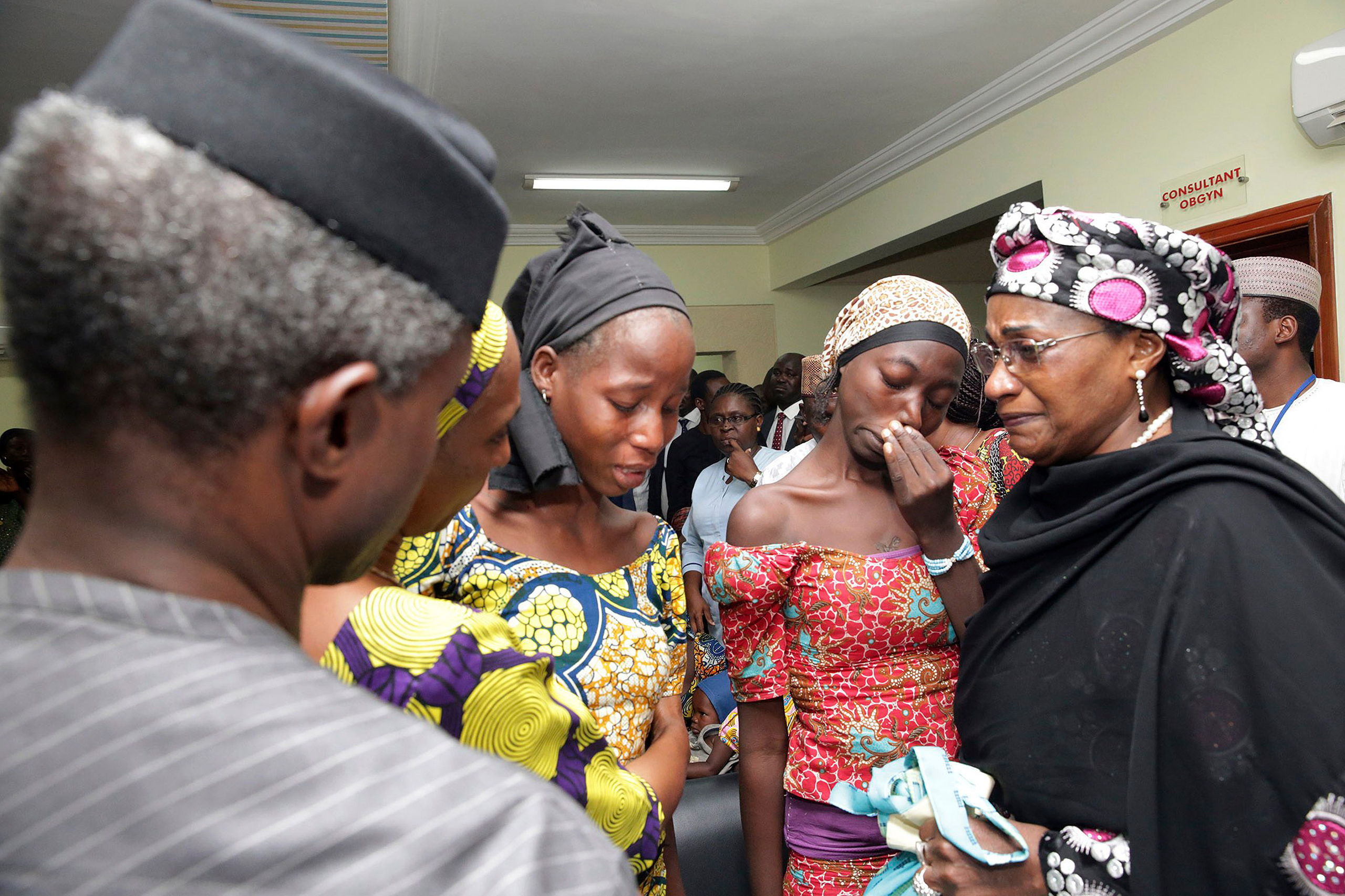 Nigeria's Vice President Yemi Osinbajo, left, welcomes some of the freed Chibok school girls at the state House in Abuja on Oct. 13, 2016. T