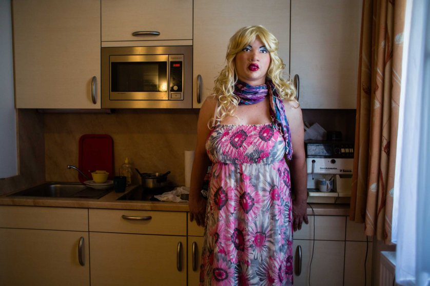 """MUNICH, GERMANY - AUGUST 04, 2015: Portrait of female masker and transsexual woman 'Bear Girl', 39, in her kitchen, August 04, 2015 in Munich, Germany. """"My biggest dream is to be a beautiful woman. I am not a topmodel and don't have an ideal physique, but the illusion is almost perfect. It is like being in another world, like a drug. I don't smoke, I don't drink, I have no passion other than that. For me it is a way of living out a deeper part of myself. """"- Female Masker Leyla alias Bear Girl, 39, transsexual woman"""