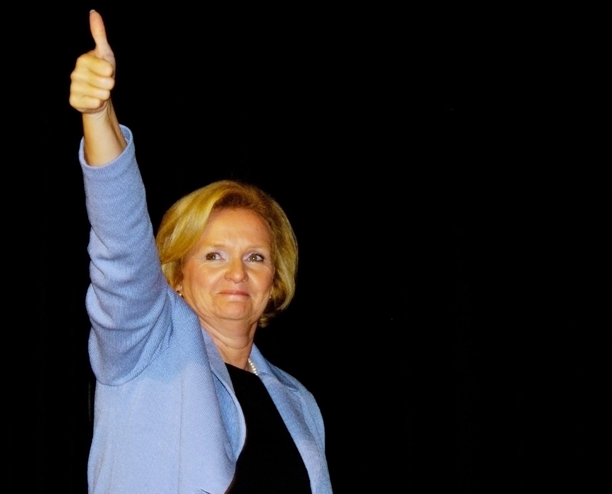 Claire McCaskill, Democratic Missouri U.S. Senate candidate, gestures to the crowd as she prepares to leave the stage with former U.S. President Bill Clinton during a rally Saturday, Sept. 9, 2006, at The Pageant theater in St. Louis.