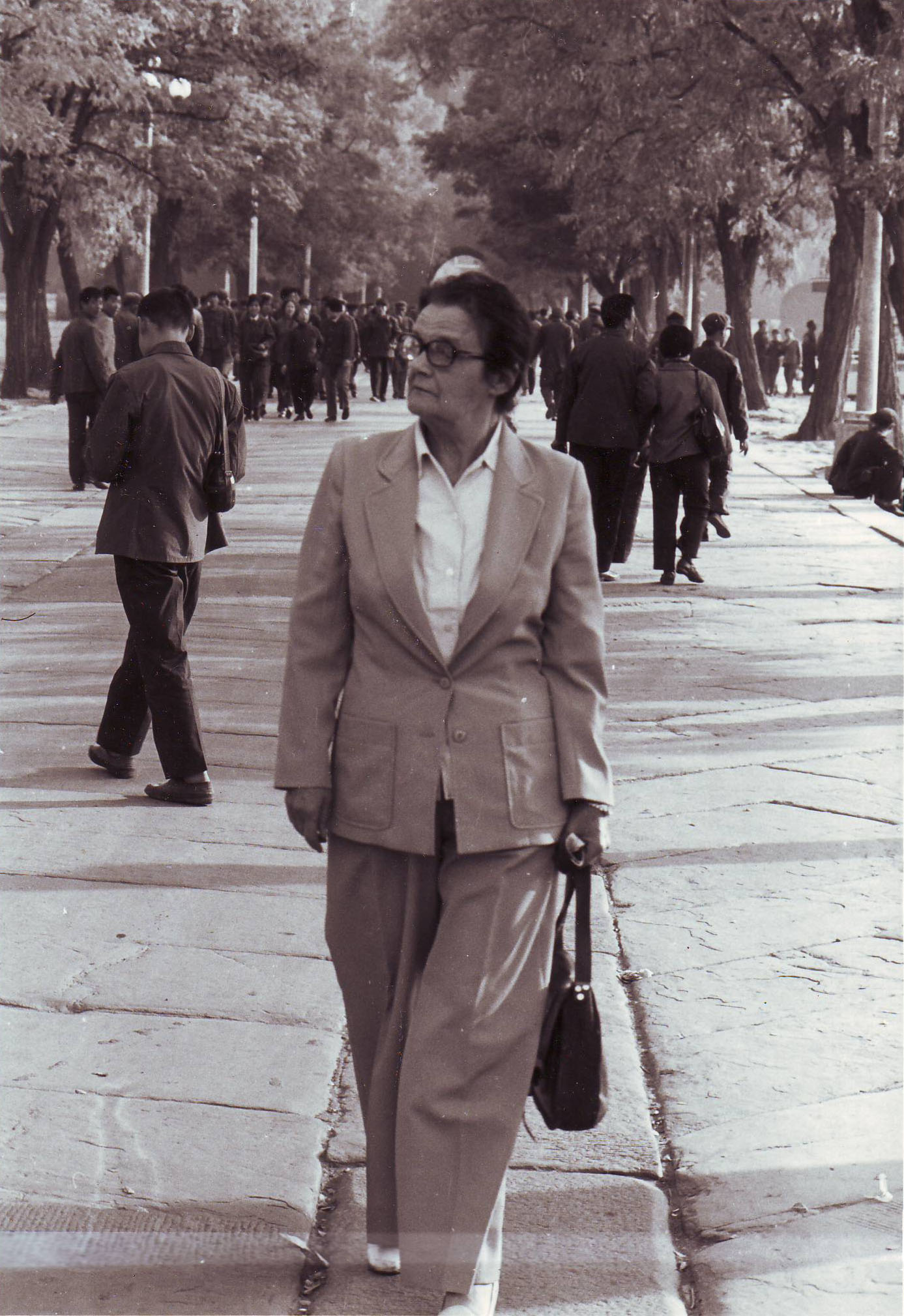 Clare Hollingworth strolls on a street in Beijing in the 1970s/80s.