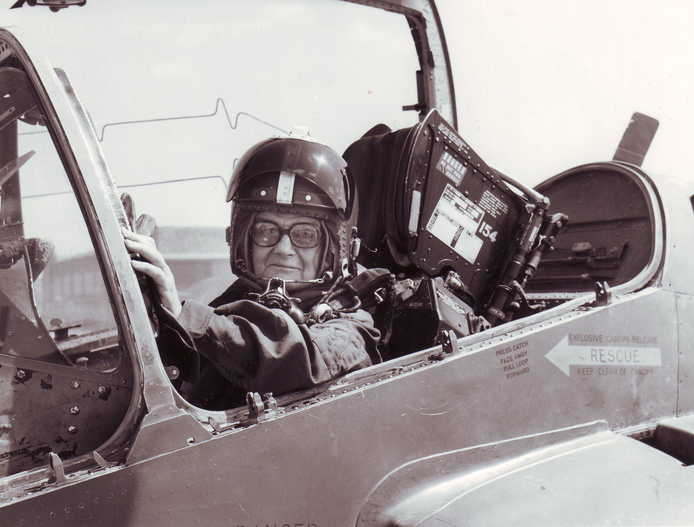 Clare in a jet, likely British RAF, during her time as Daily Telegraph defense correspondent, sometime between 1976 and 1981