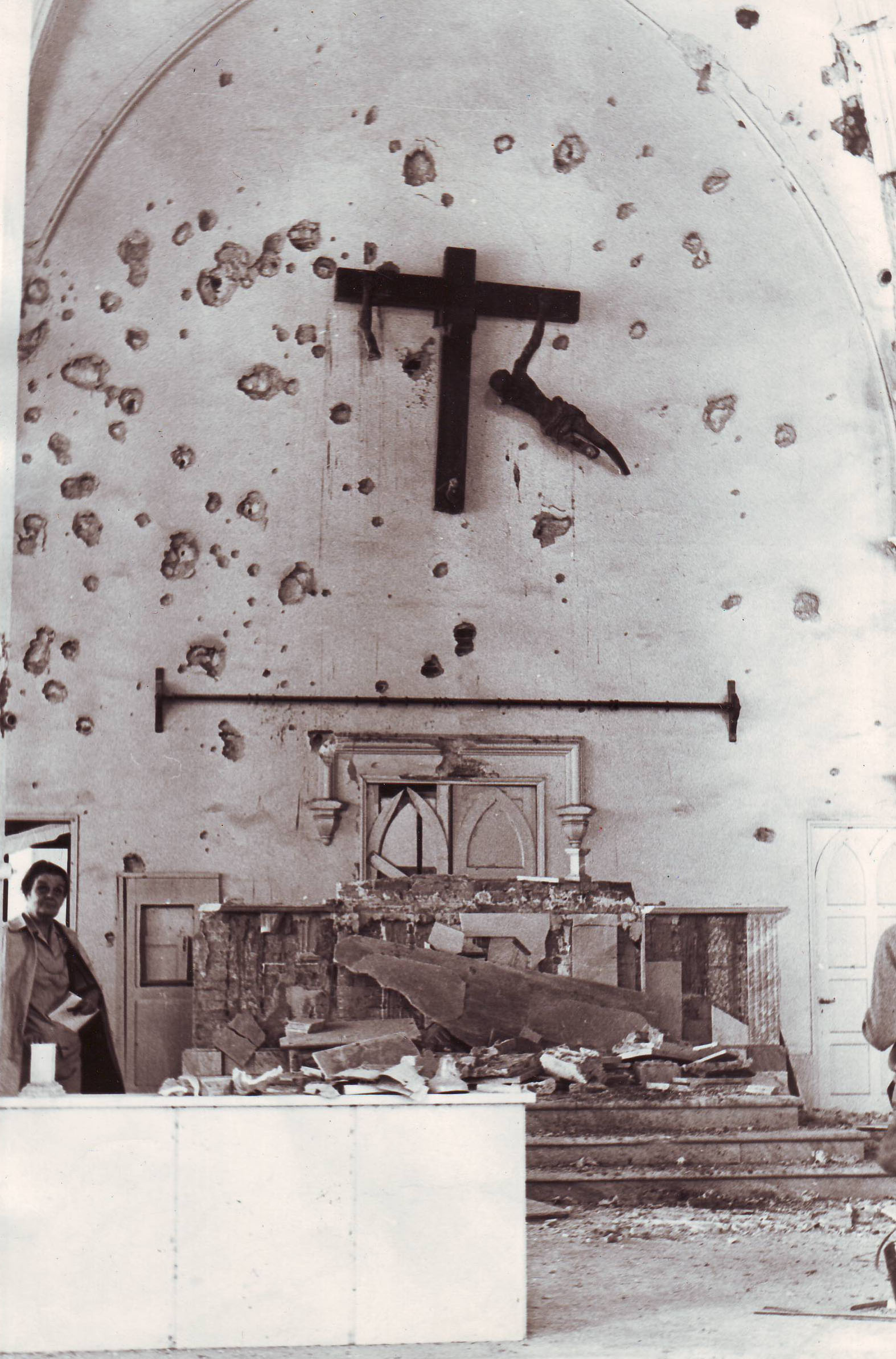 Clare Hollingworth looks into a battered church, likely during Bangladesh's war for independence in the early 1970s