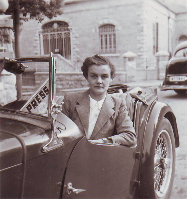 Clare Hollingworth in a car, likely late 1940s, early 1950s