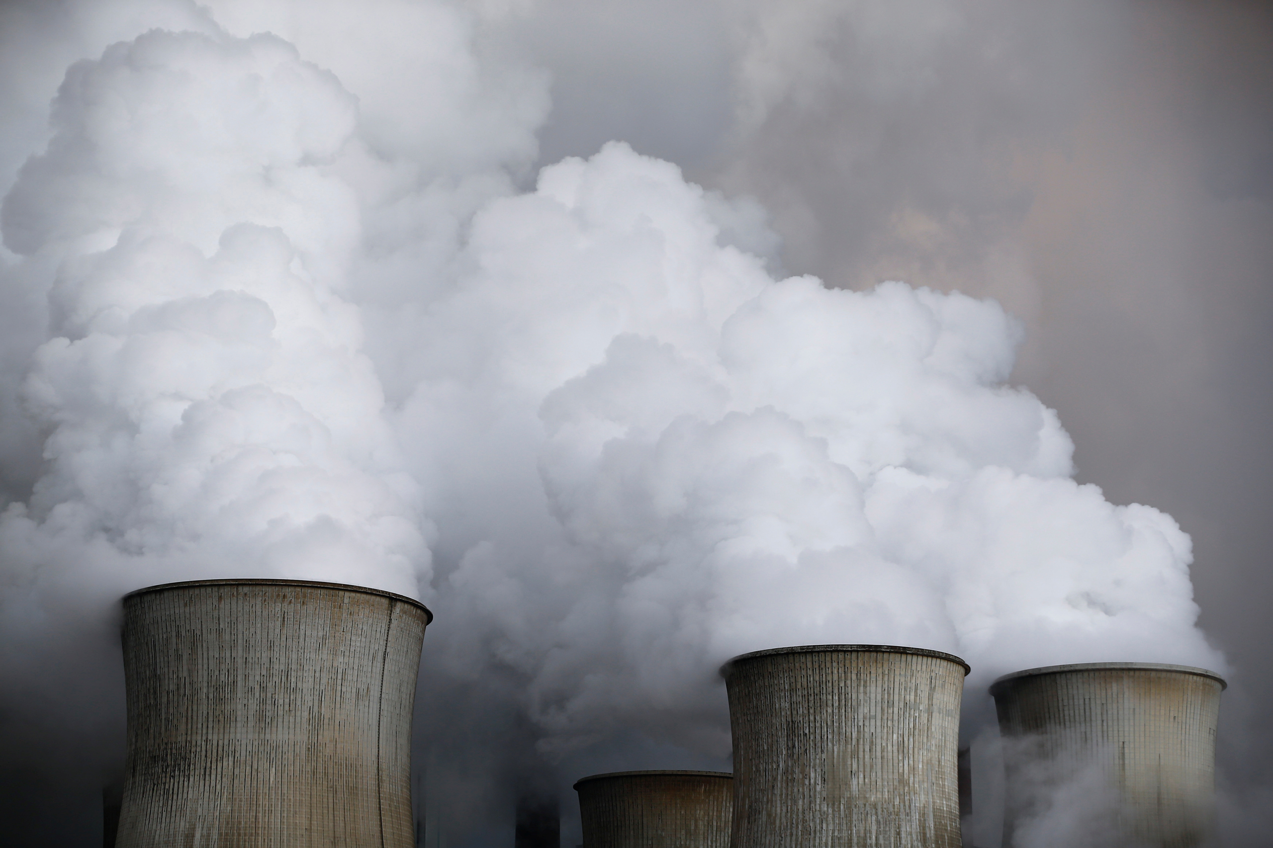 Steam rises from the cooling towers of the coal power plant of RWE, one of Europe's biggest electricity and gas companies in Niederaussem, Germany, on Mar. 3, 2016.