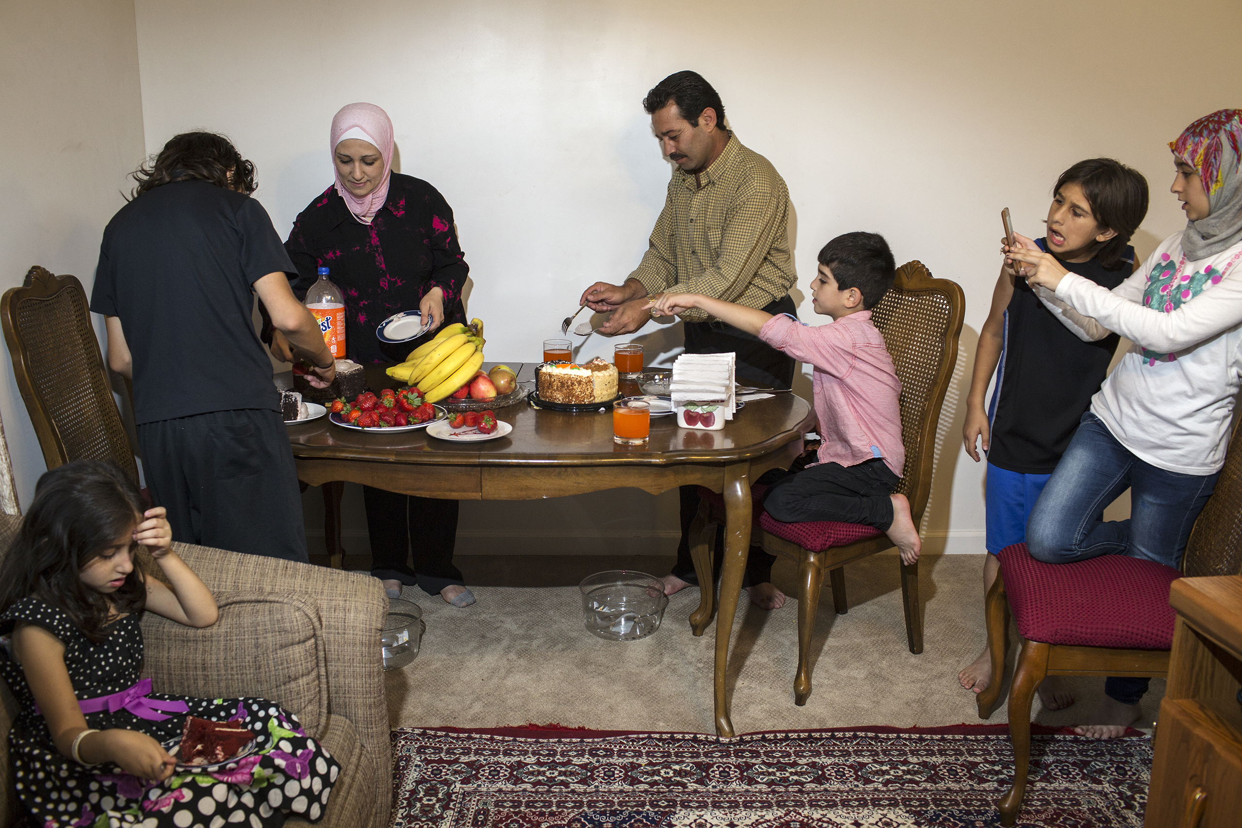 Ghazweh and her husband, Abdul Fattah, celebrate their 17th wedding anniversary with their children at their apartment in Des Moines, Iowa.