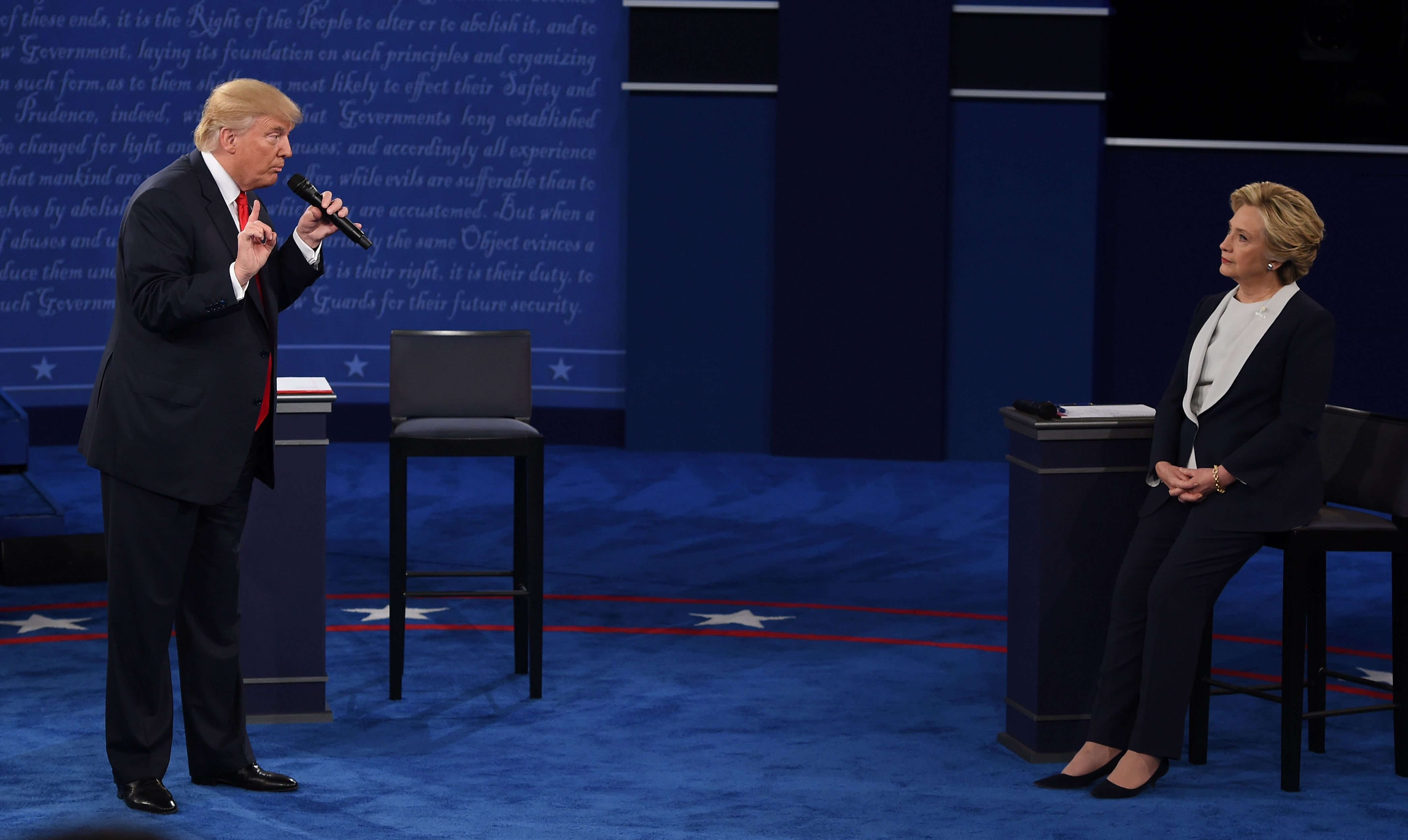 Democratic presidential candidate Hillary Clinton and Republican presidential candidate Donald Trump debate during the second presidential debate at Washington University in St. Louis on Oct. 9, 2016.