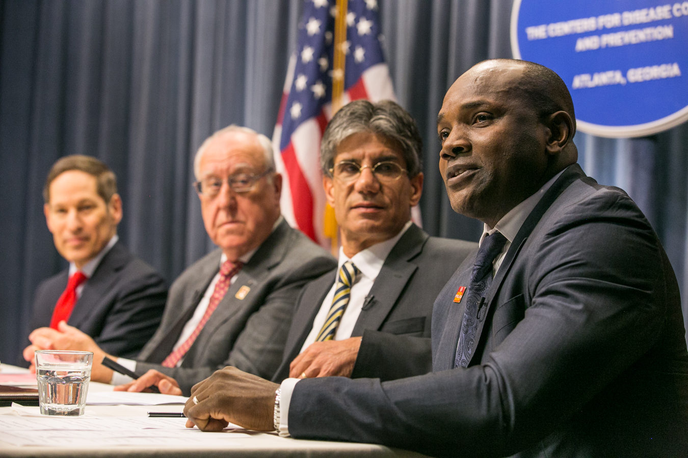 Dennis Ogbe, right, during a World Polio Day panel at the CDC
