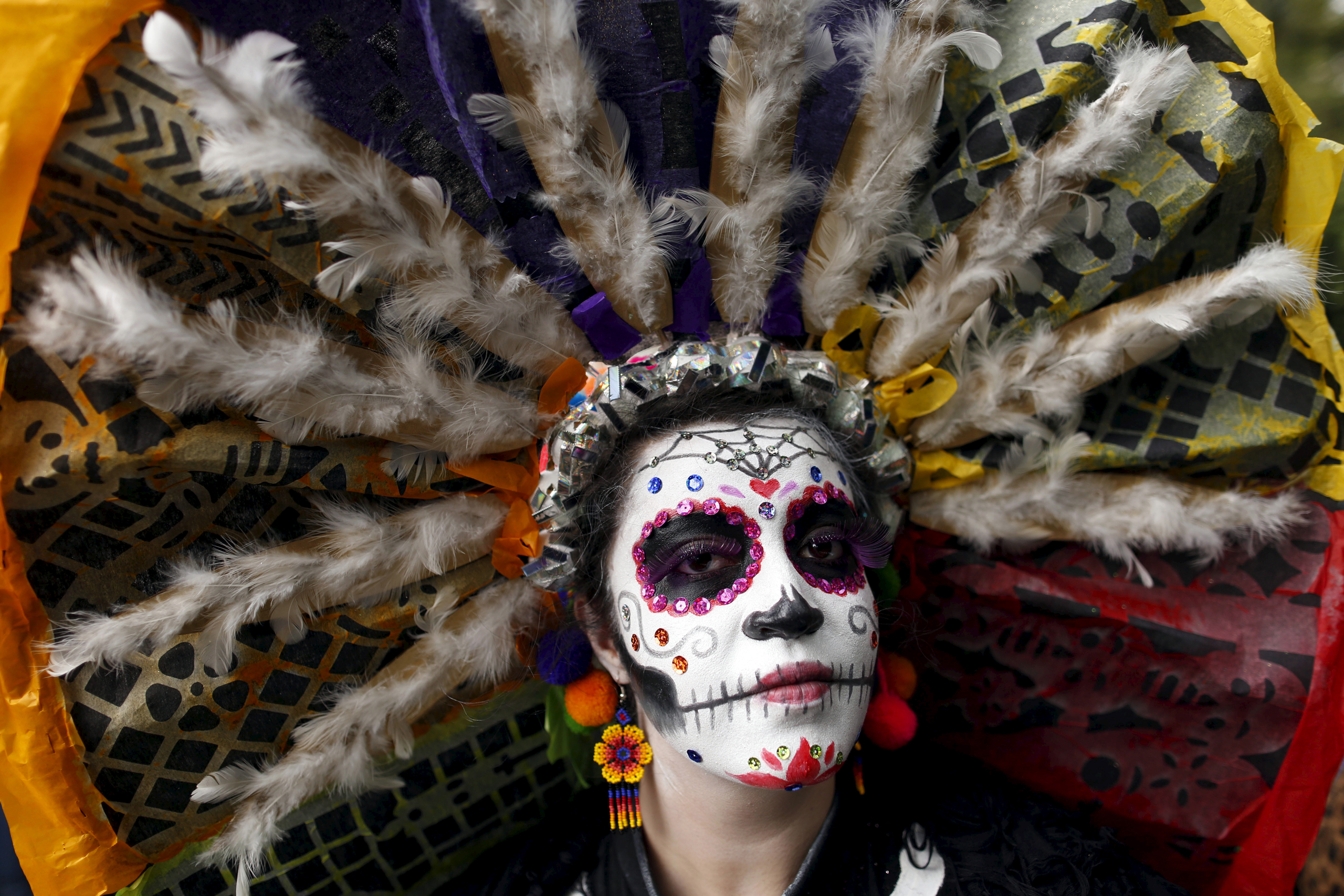 A woman with her face painted to look like the popular Mexican figure called  Catrina , poses for a photograph as she takes part in the annual Catrina Fest in Mexico City on Nov. 1, 2015.