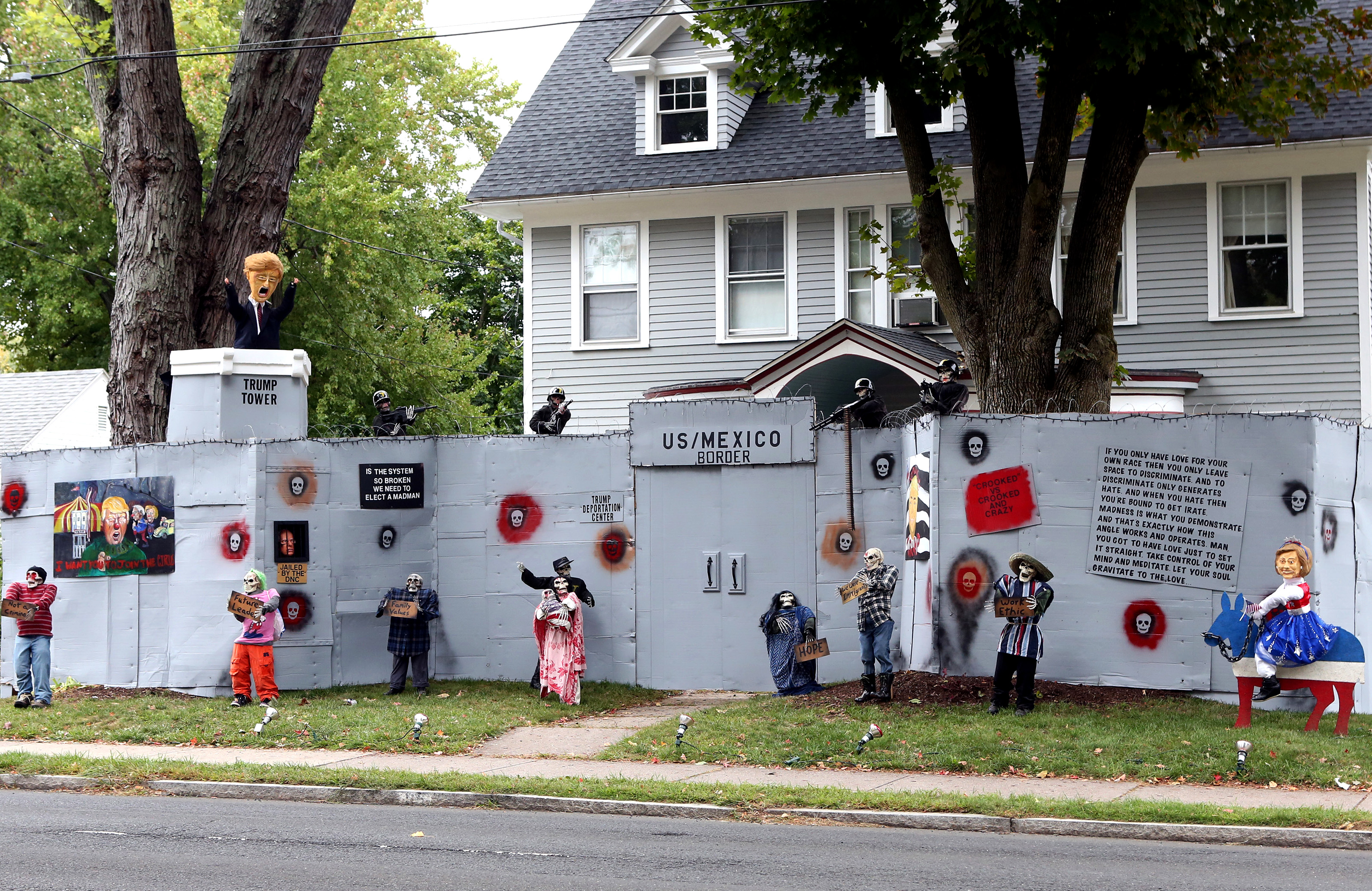 A display features a  border wall  and figures in the likeness of Donald Trump, Hillary Clinton and Bernie Sanders on the property of Matt Warshauer in West Hartford, Conn. on Oct. 4, 2016.