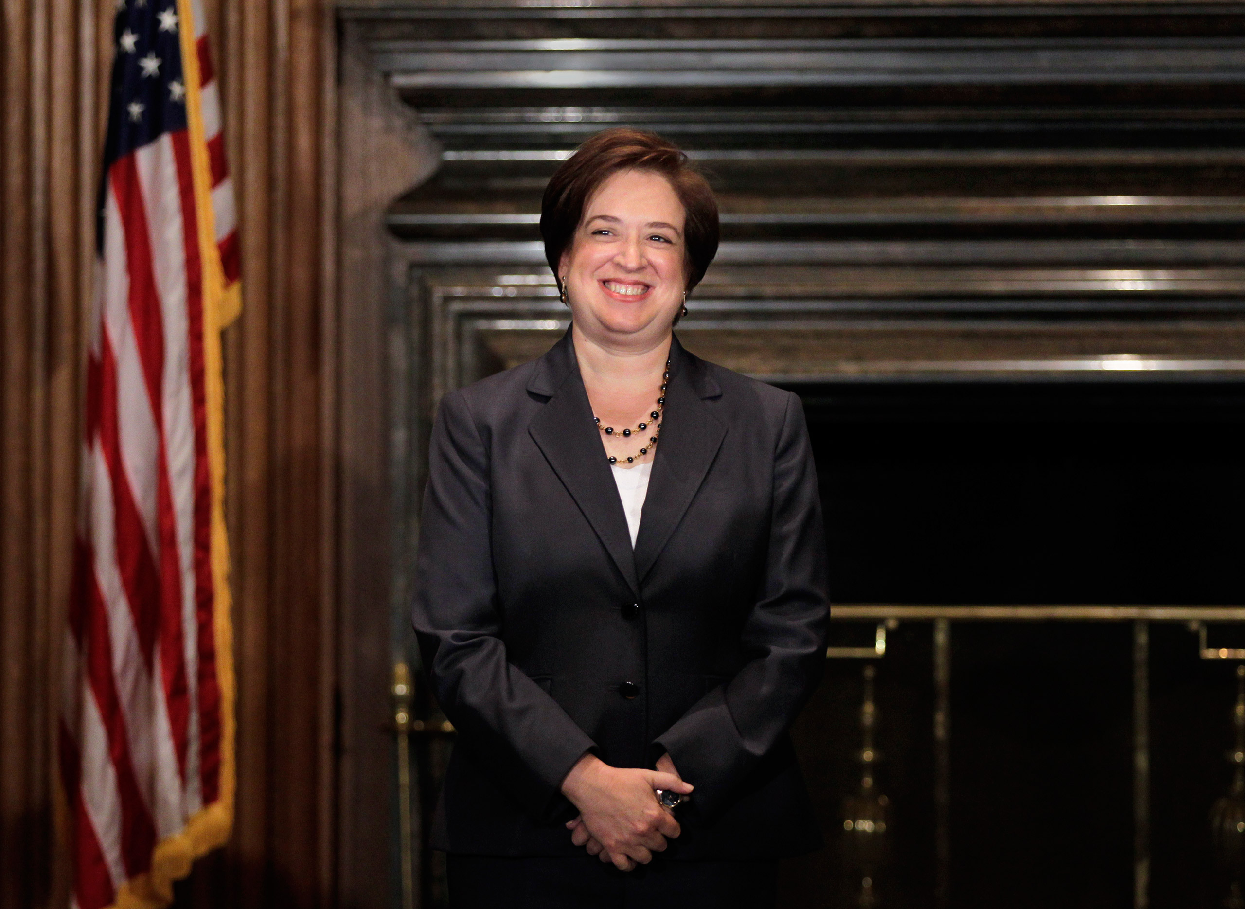 Elena Kagan smiles after being sworn in as the Supreme Court's newest member by Chief Justice John Roberts at the Supreme Court Building August 7, 2010 in Washington, DC.