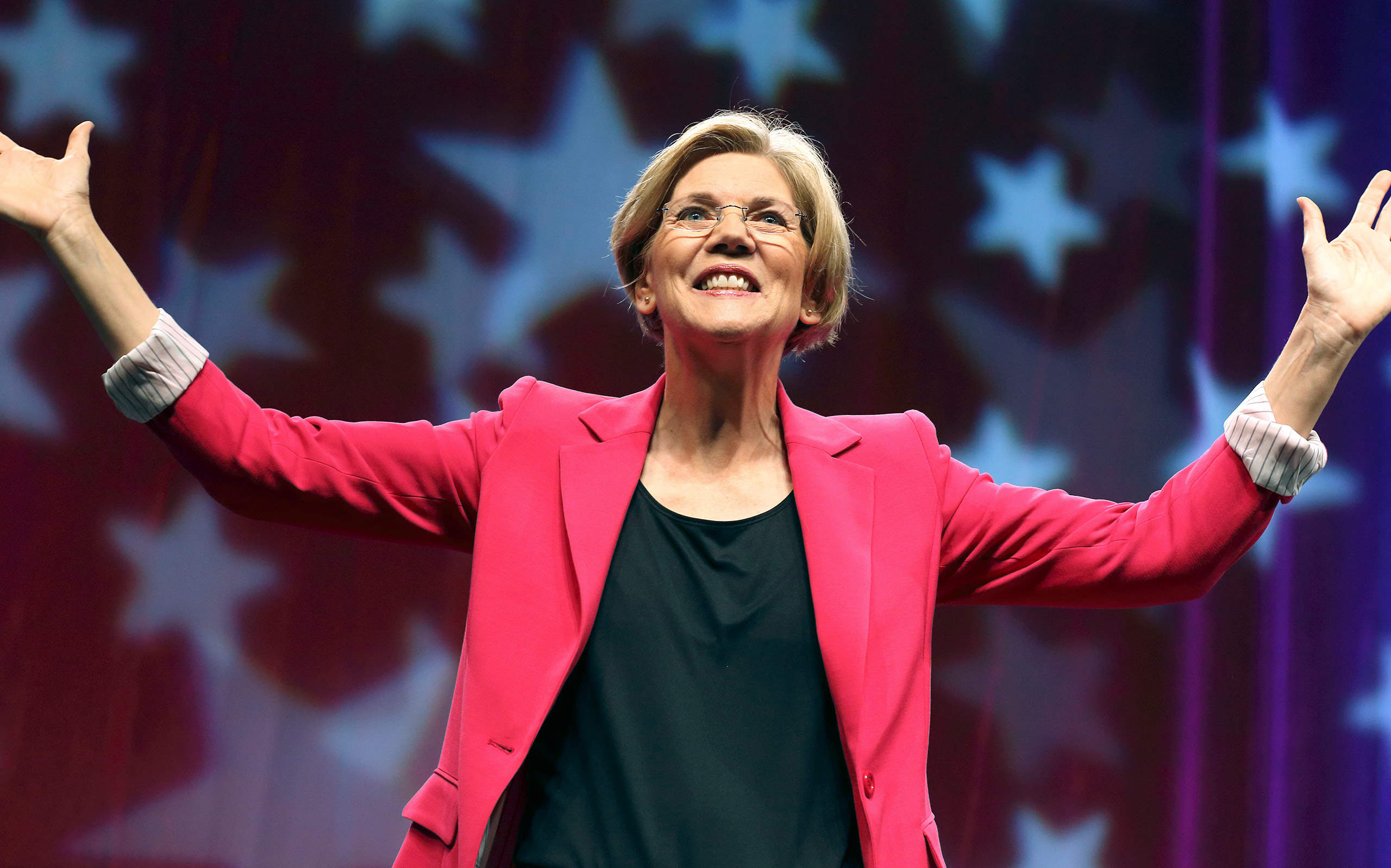 Elizabeth Warren looks to the audience after addressing the Democratic State Convention before the delegate vote in Springfield, Mass. on Saturday, June 2, 2012.