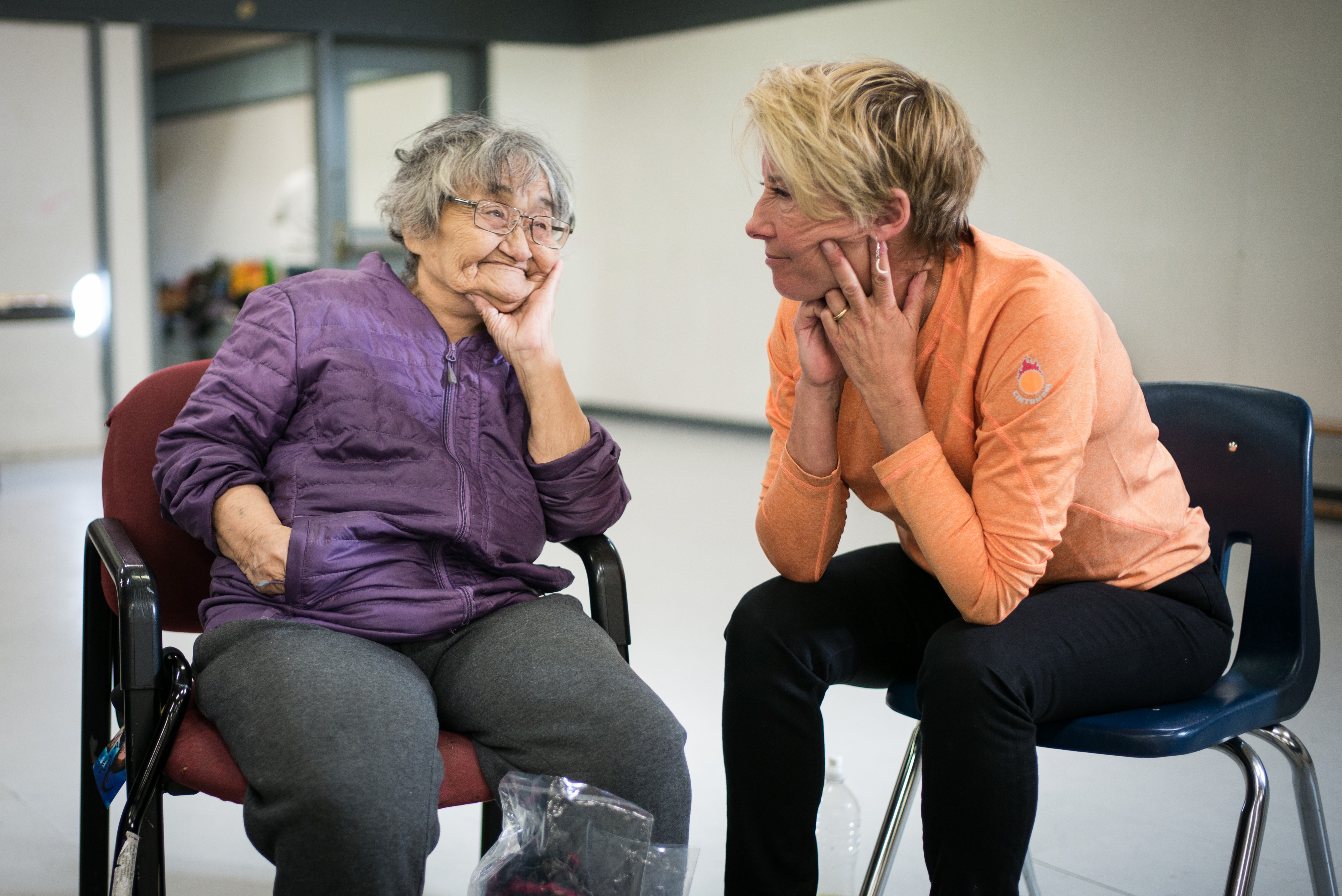 Clyde River elder Iga Palluq speaks with Emma Thompson at the Clyde River community center.