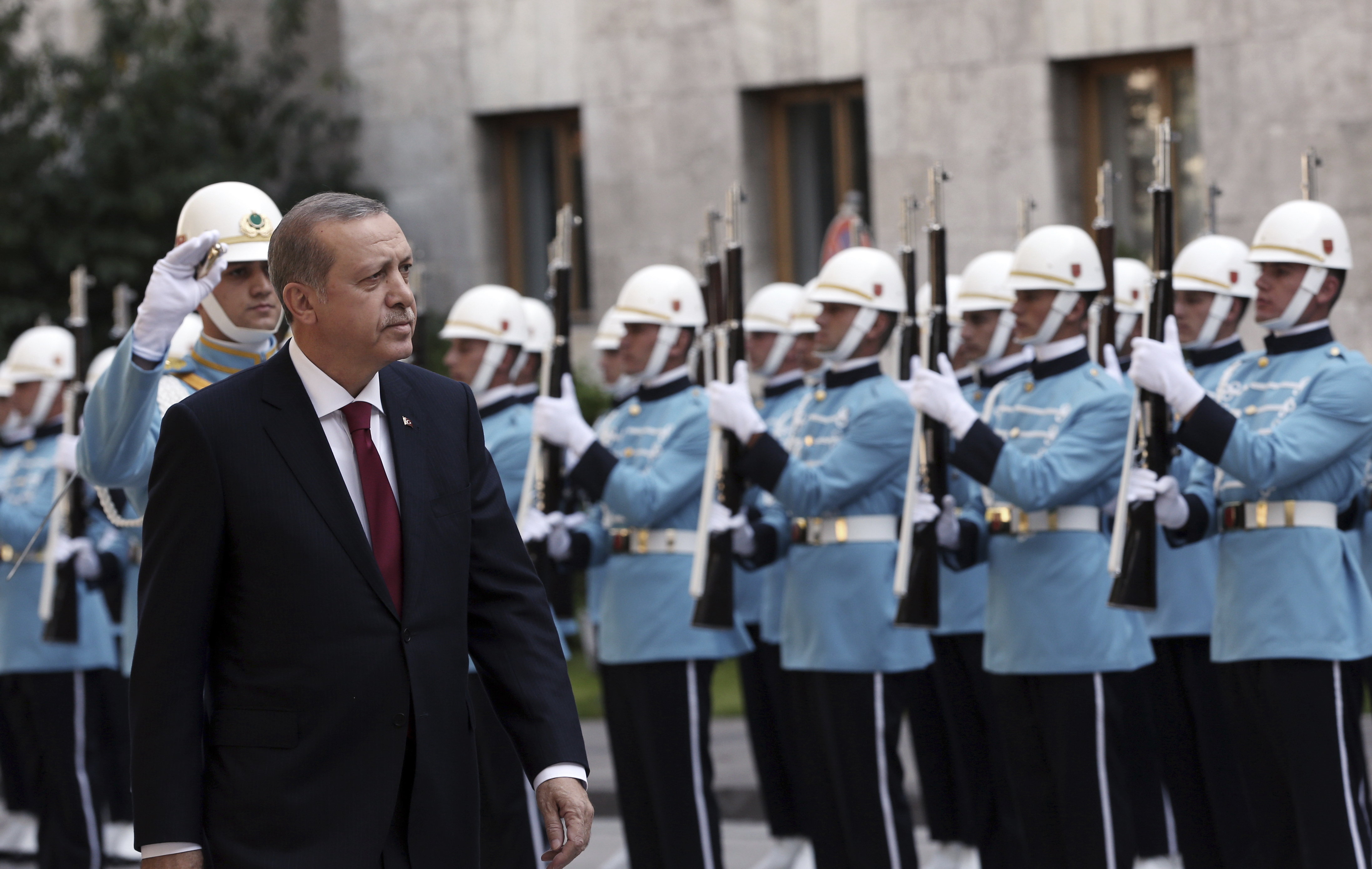 Turkey's President Recep Tayyip Erdogan inspects a military honour guard as he arrives to address the parliament in Ankara, Turkey, Saturday, Oct. 1, 2016.