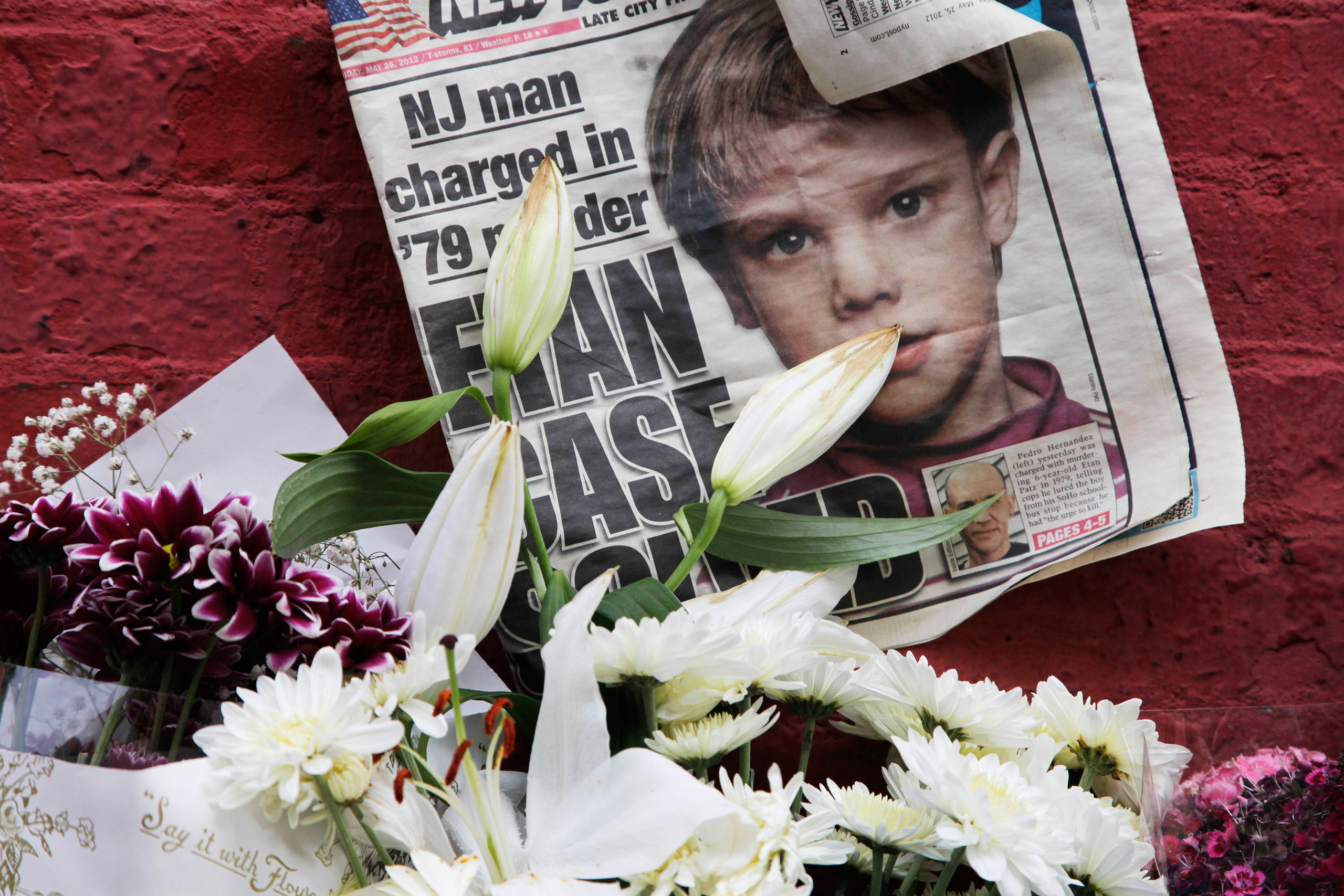 A newspaper with a photograph of Etan Patz is part of a makeshift memorial in the SoHo neighborhood of New York, on May 28, 2012.