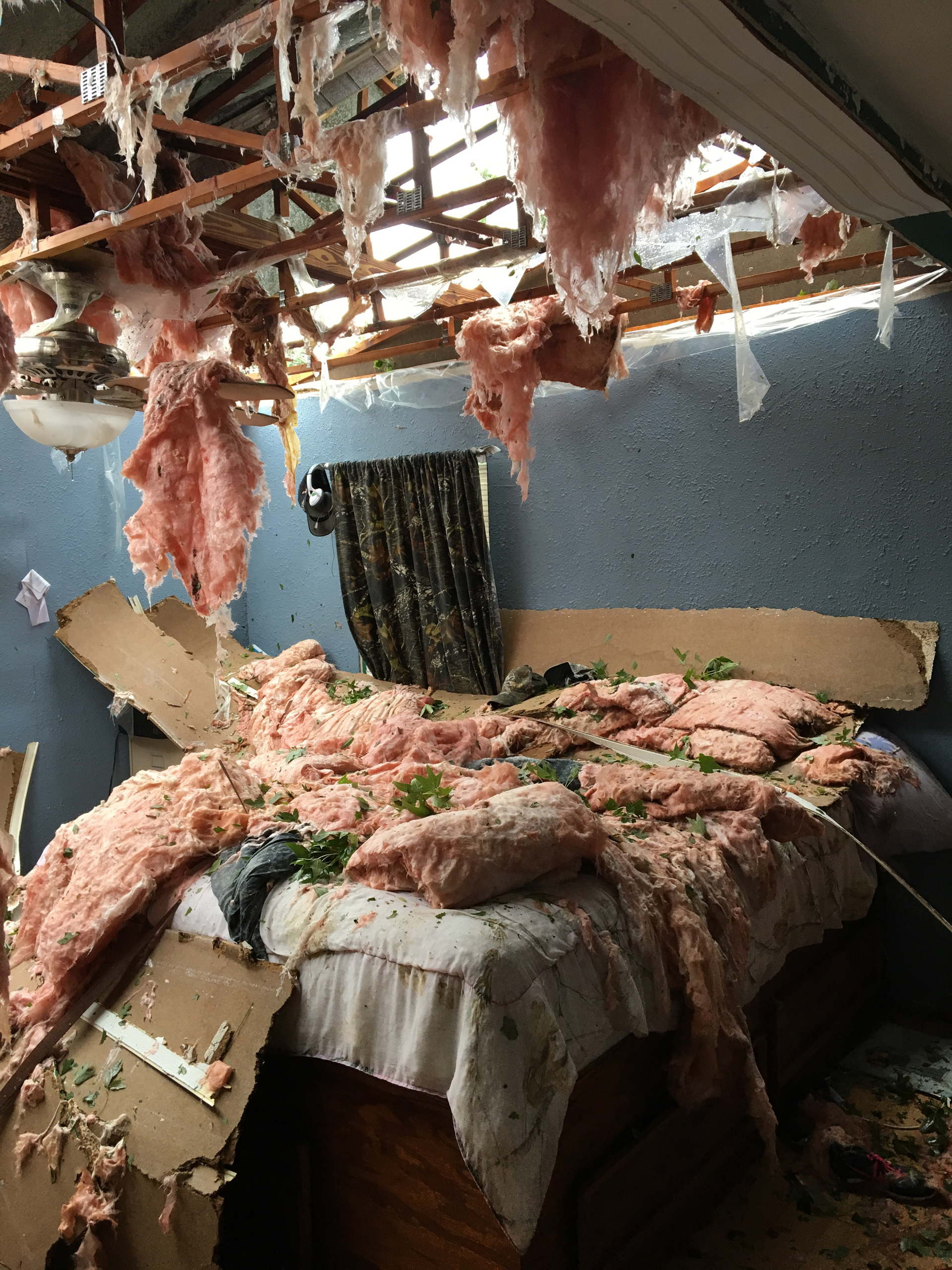 The ceiling in Cristy and Jeremy Emerson's house collapsed after Hurricane Matthew hit Oak Hill, Fla., on Oct. 7, 2016.