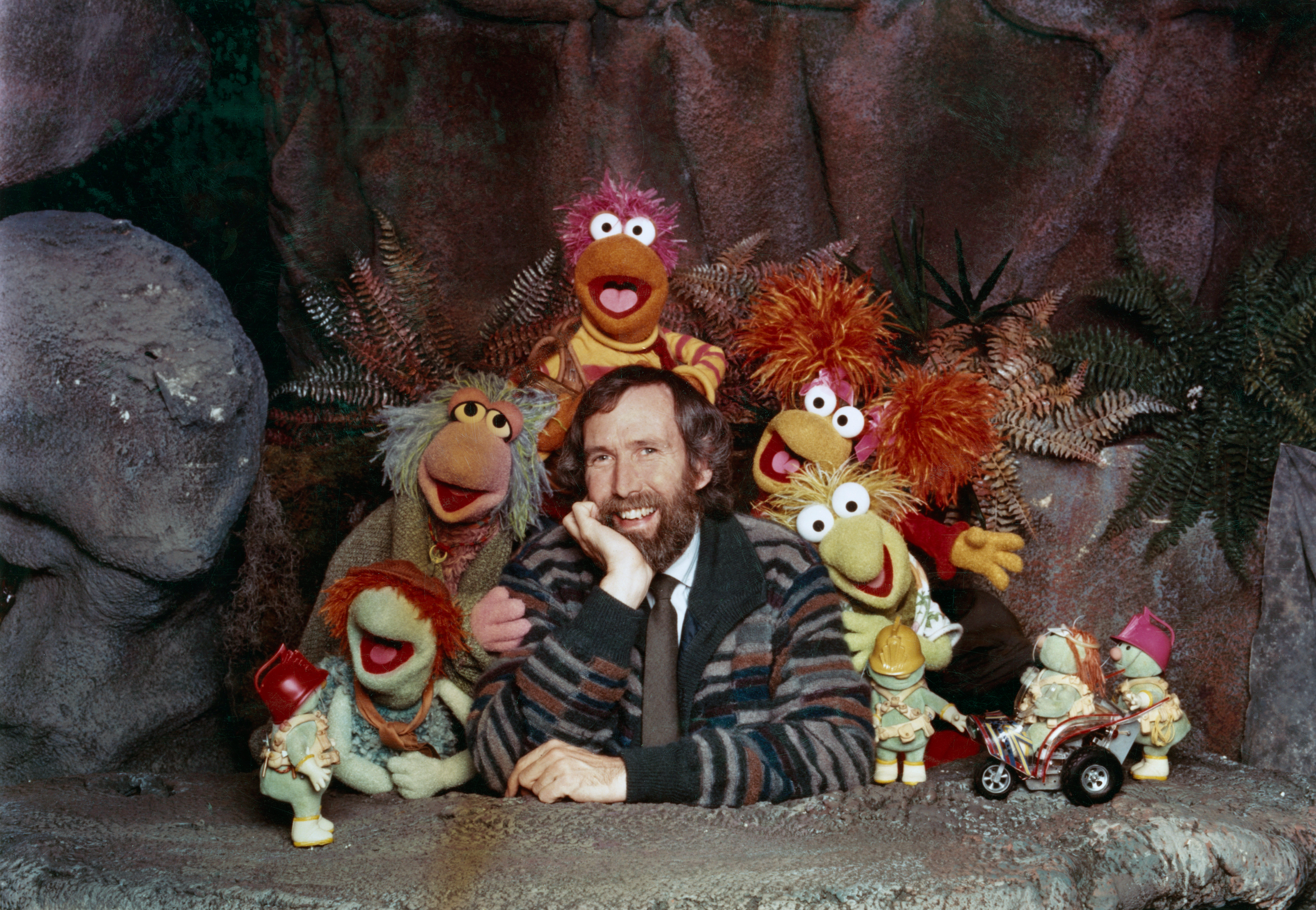American puppeteer and filmmaker Jim Henson (1936 - 1990) with some of the Muppet cast from the children's TV show 'Fraggle Rock', circa 1985. Along with the diminutive Doozers in the foreground are the Fraggle characters (left to right) Boober, Mokey, Gobo, Red and Wembley.