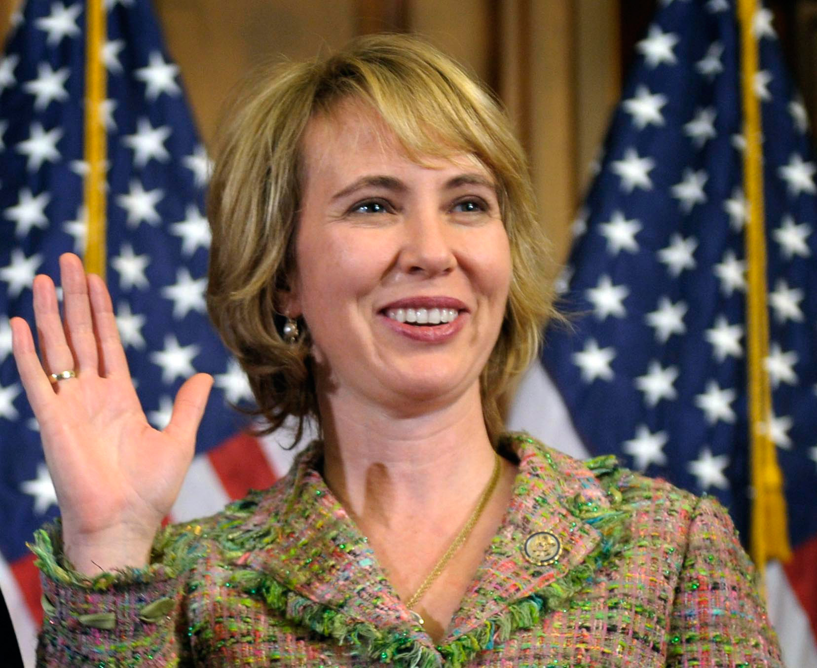 Rep. Gabrielle Giffords, D-Ariz., takes part in a reenactment of her swearing-in, on Capitol Hill in Washington, Jan. 5, 2011.