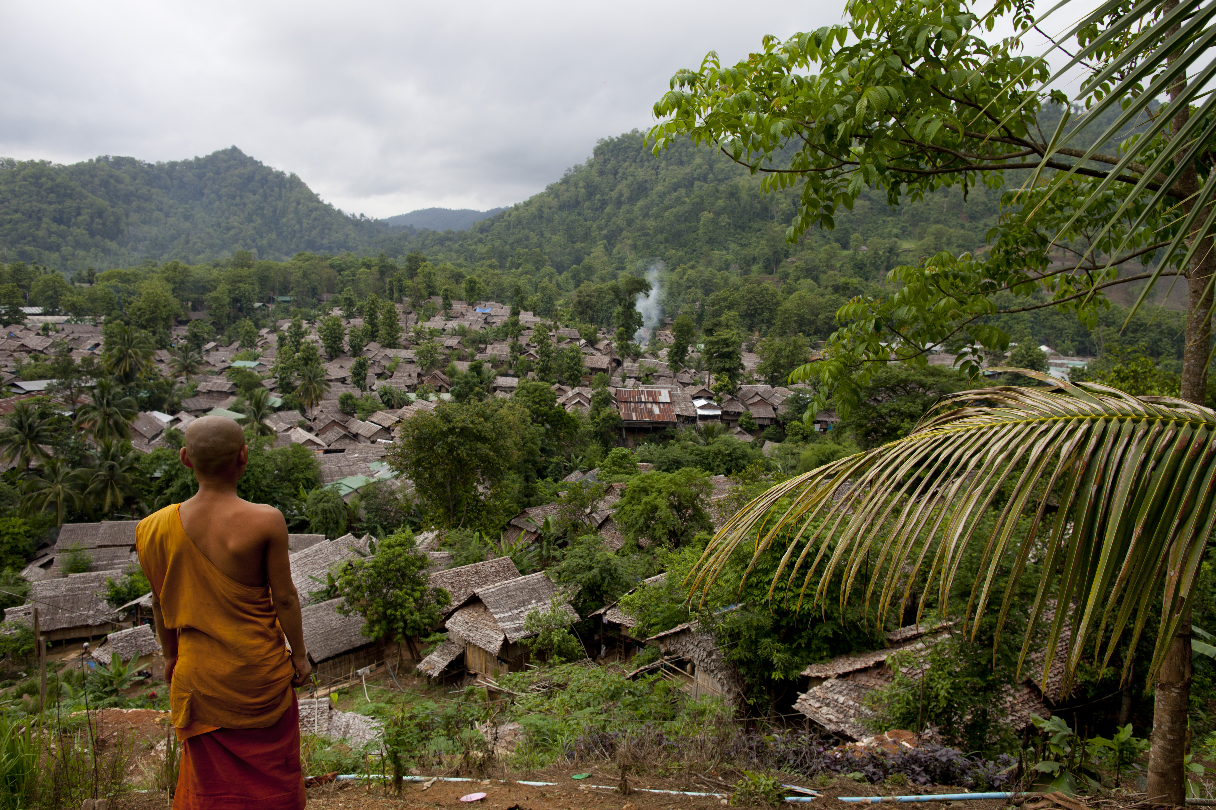 A Burmese monk looks out from a viewpoint at the Mae La refugee camp in Tak province, Thailand, on June 6, 2012