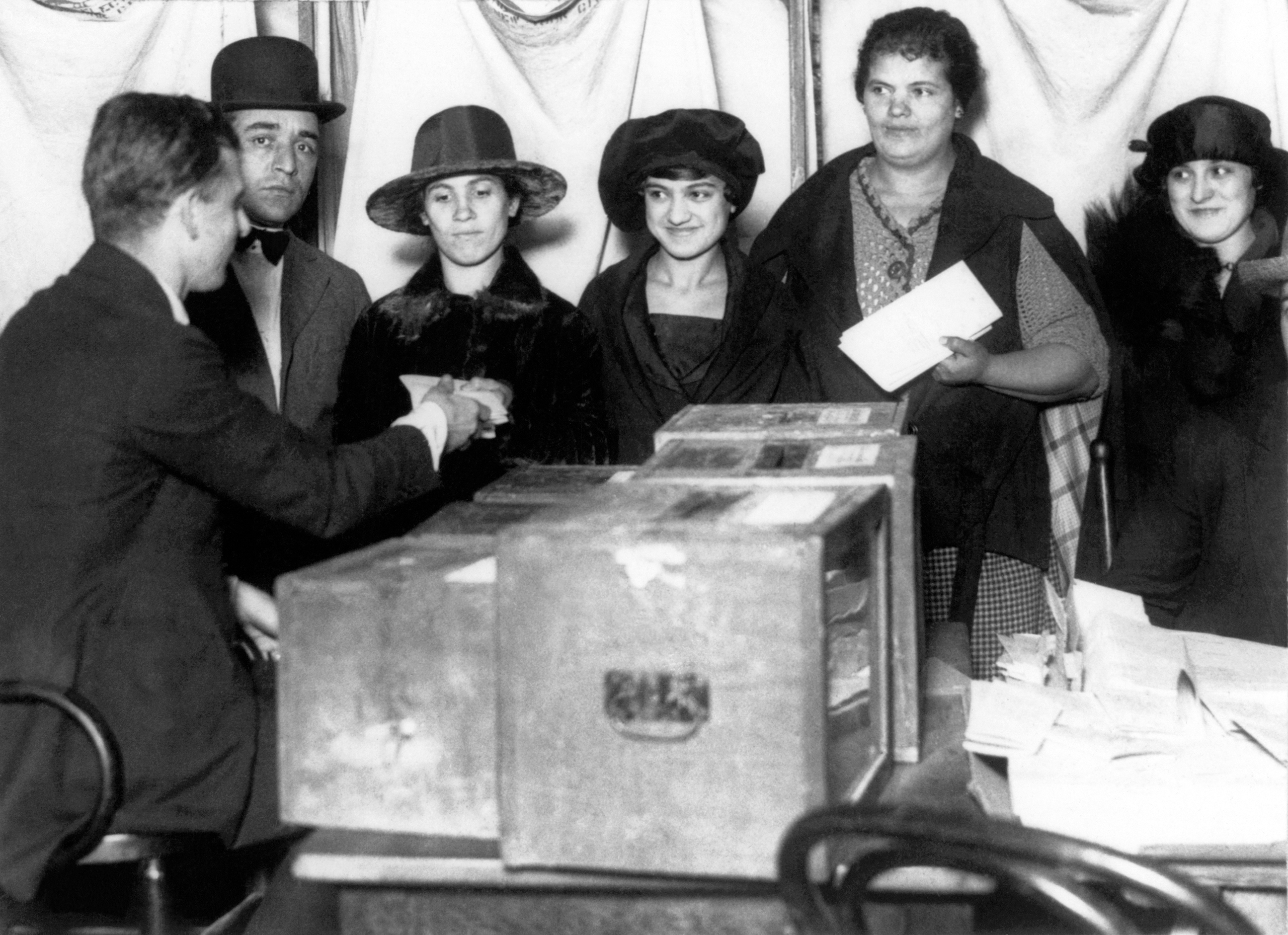 Women line up to vote for the first time in New York after the passage of the 19th Amendment, in 1920.