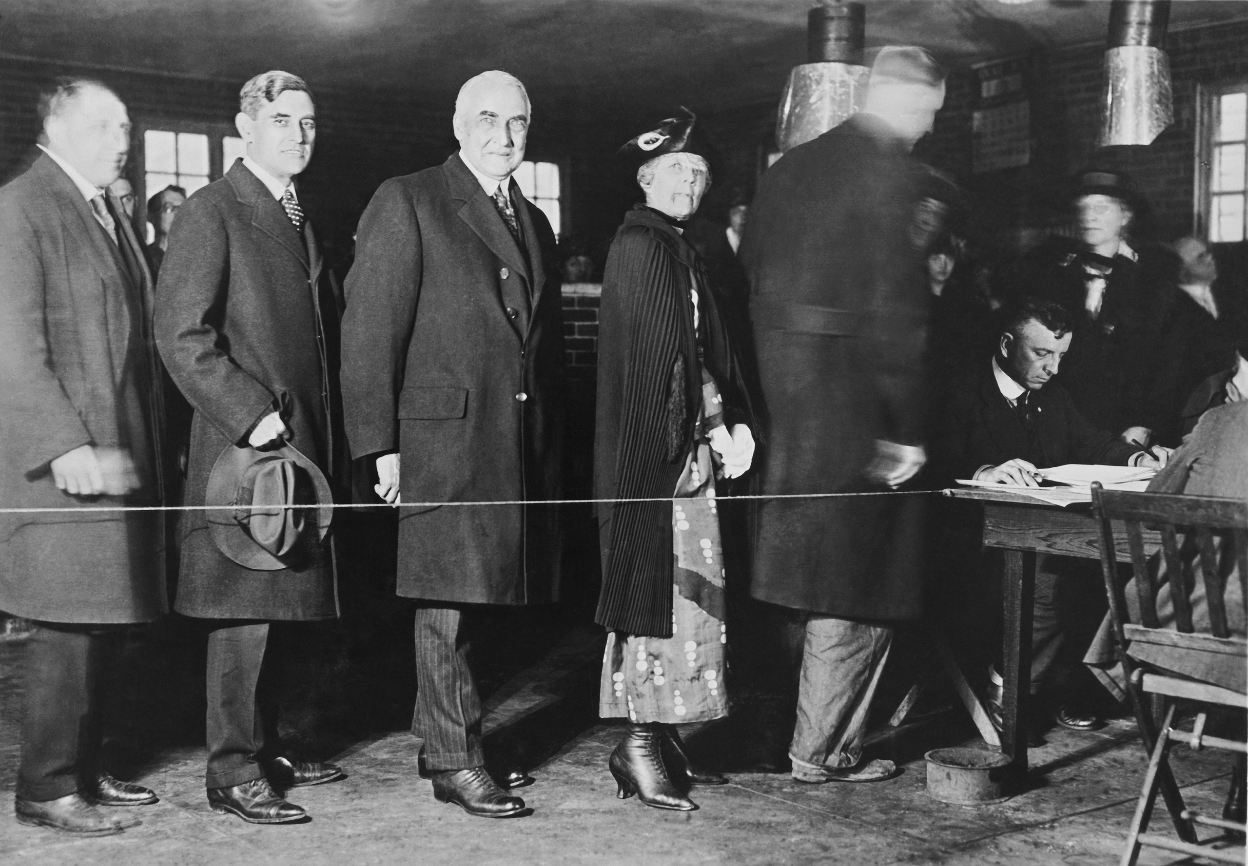 Mr. and Mrs. Warren G. Harding stand in line to vote in the presidential election, in 1920.