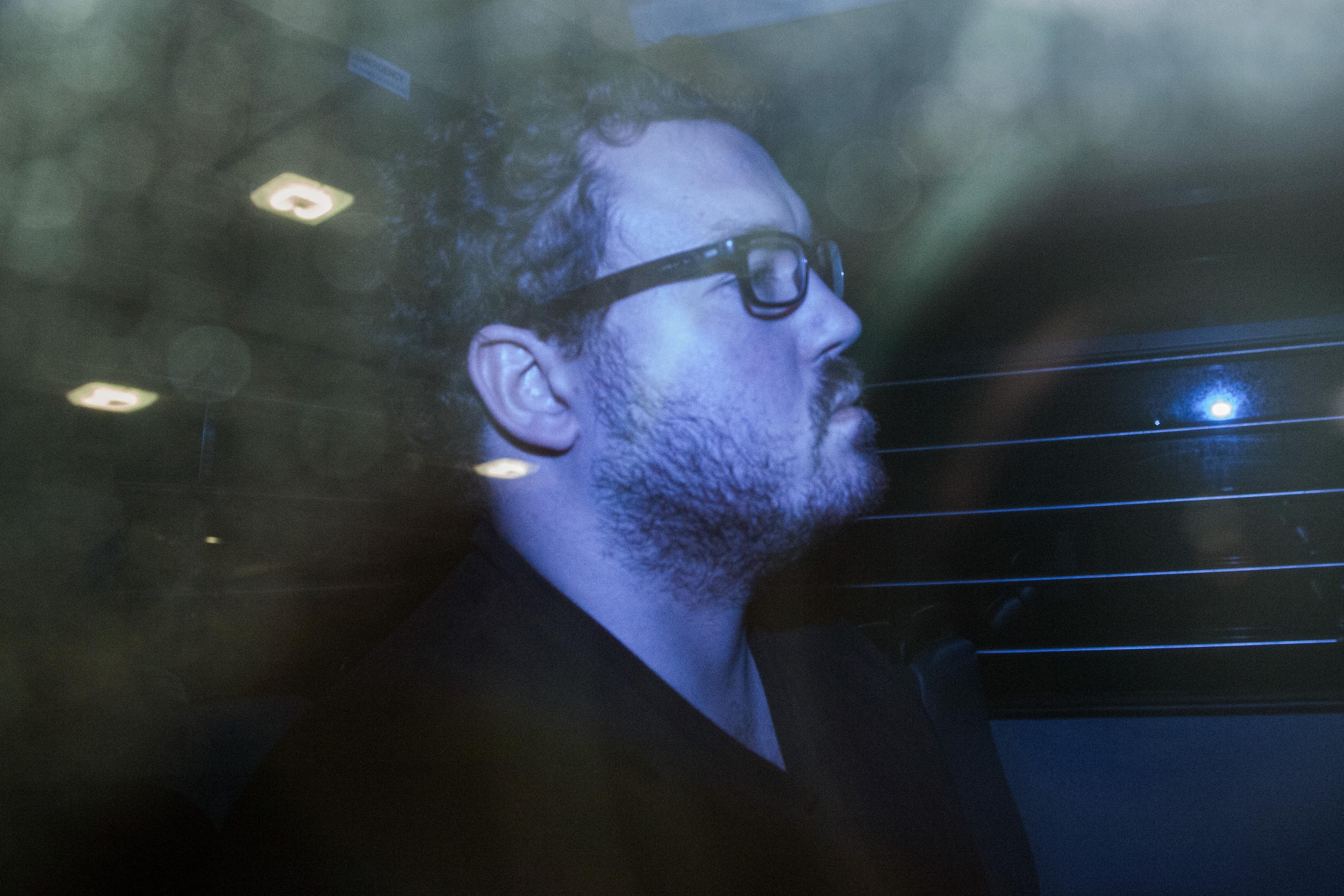 Rurik George Caton Jutting leaves the Eastern Magistrates' Court in a prison van in Hong Kong on Nov. 3, 2014