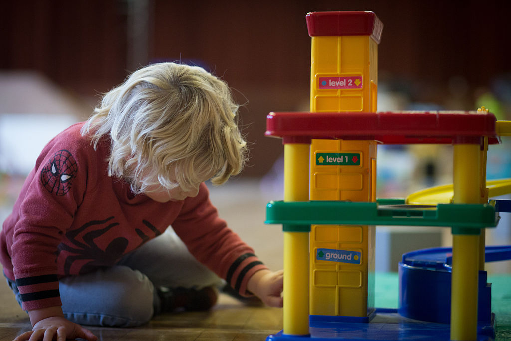 RADSTOCK, UNITED KINGDOM - JANUARY 06:  A young boy plays with toys at a playgroup for pre-school aged children in Chilcompton near Radstock on January 6, 2015 in Somerset, England. Along with the health and the economy, education and childcare are to be key issues in the forthcoming election.  (Photo by Matt Cardy/Getty Images)