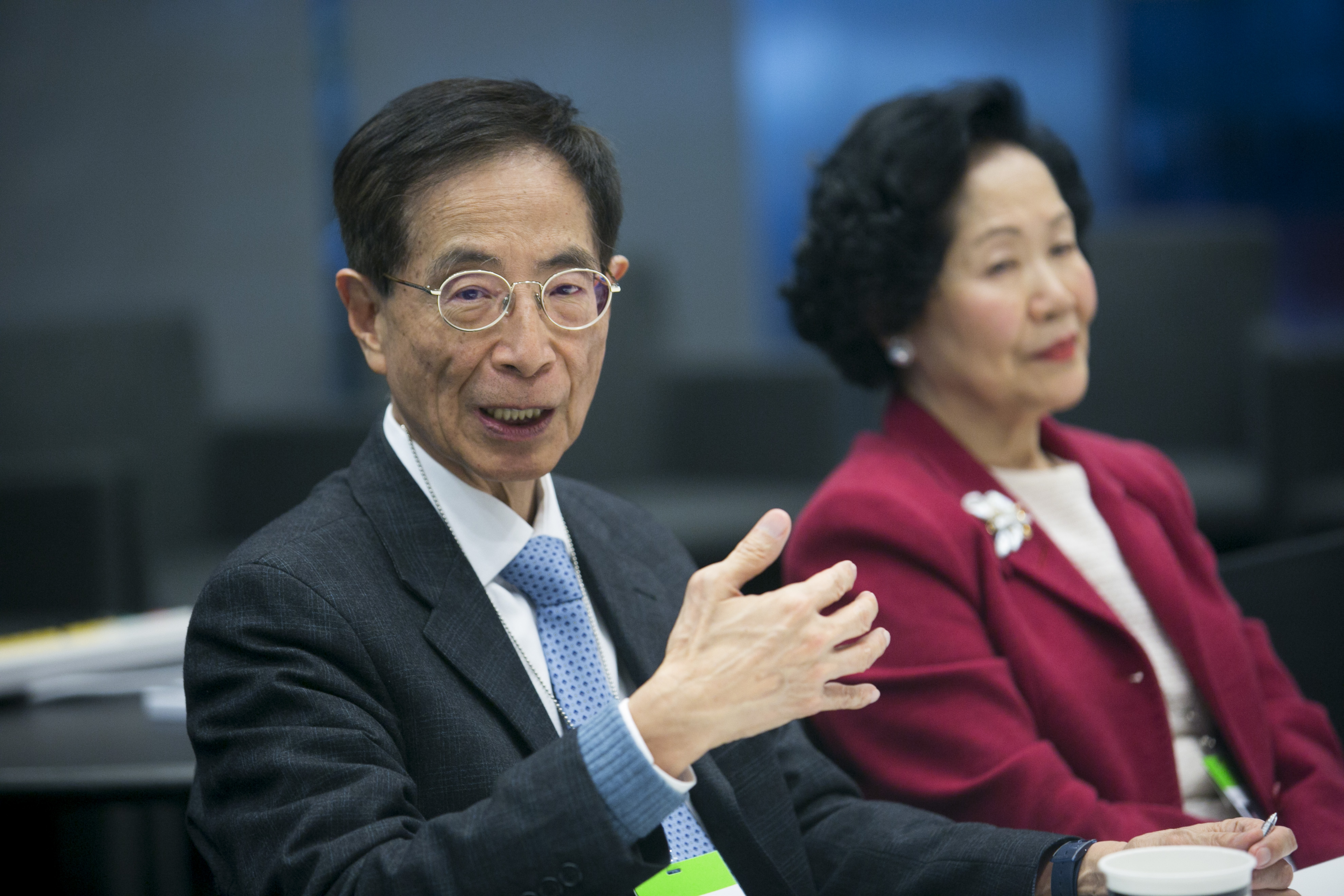 Martin Lee, former member of Hong Kong's Legislative Council, left, speaks as Anson Chan, Hong Kong's former top civil servant, listens during an interview in New York City on March 31, 2014