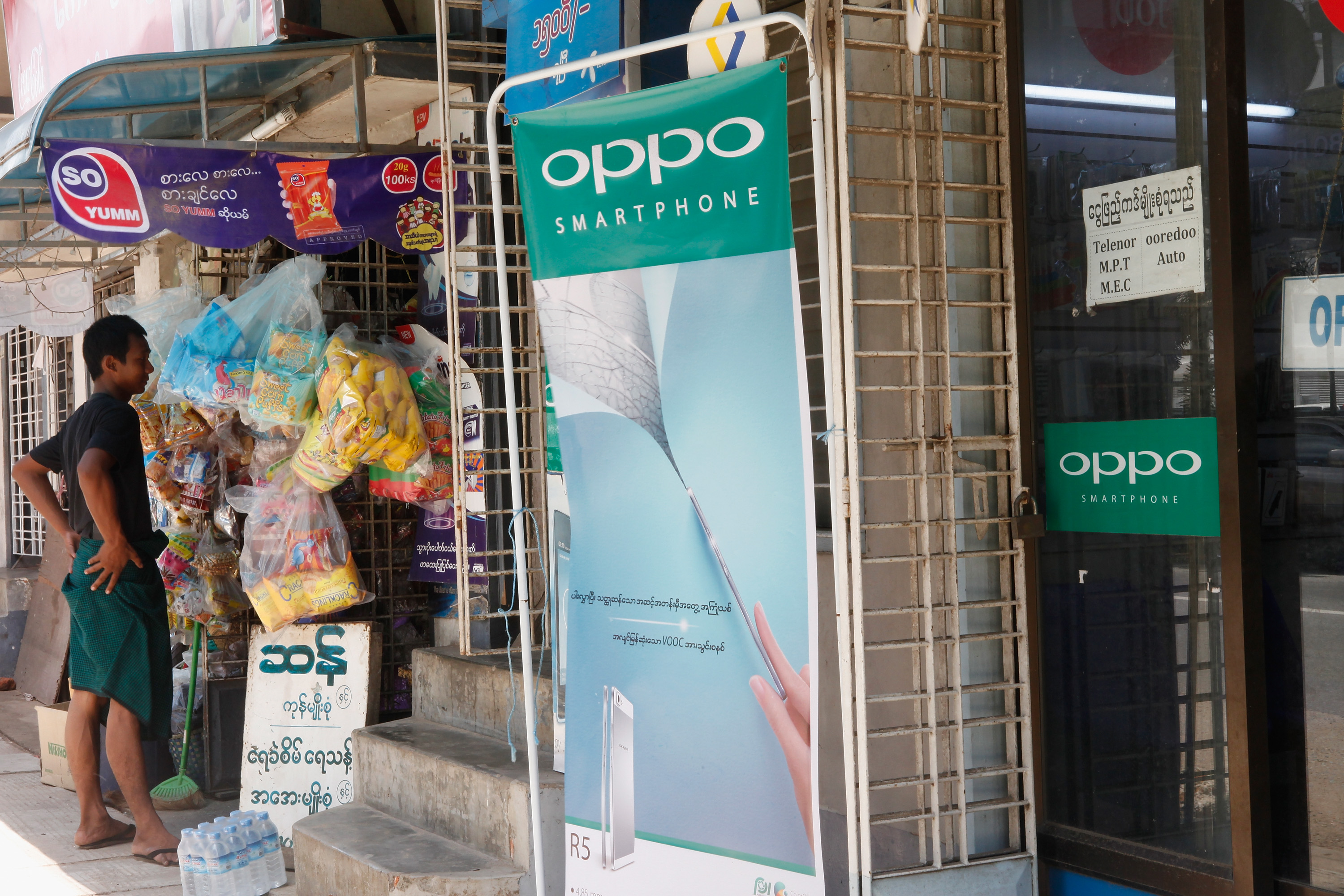 Chinese mobile phone manufacturers Oppo's advertising is in the streets on June 5, 2015 in Yangon, Myanmar.
