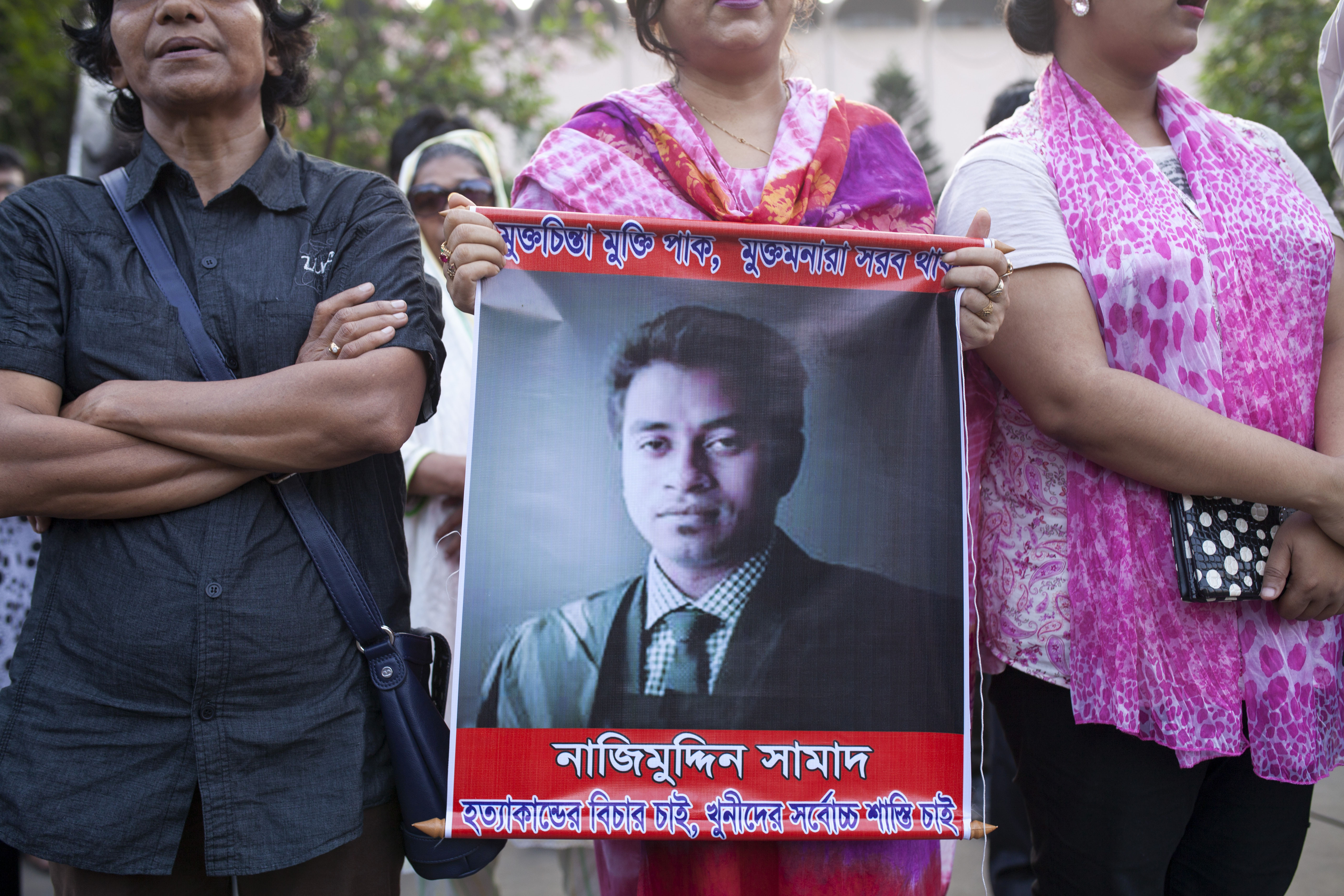 Activists protest at a rally over the murder of activist Nazimuddin Samad on April 7, 2016, in Dhaka, Bangladesh