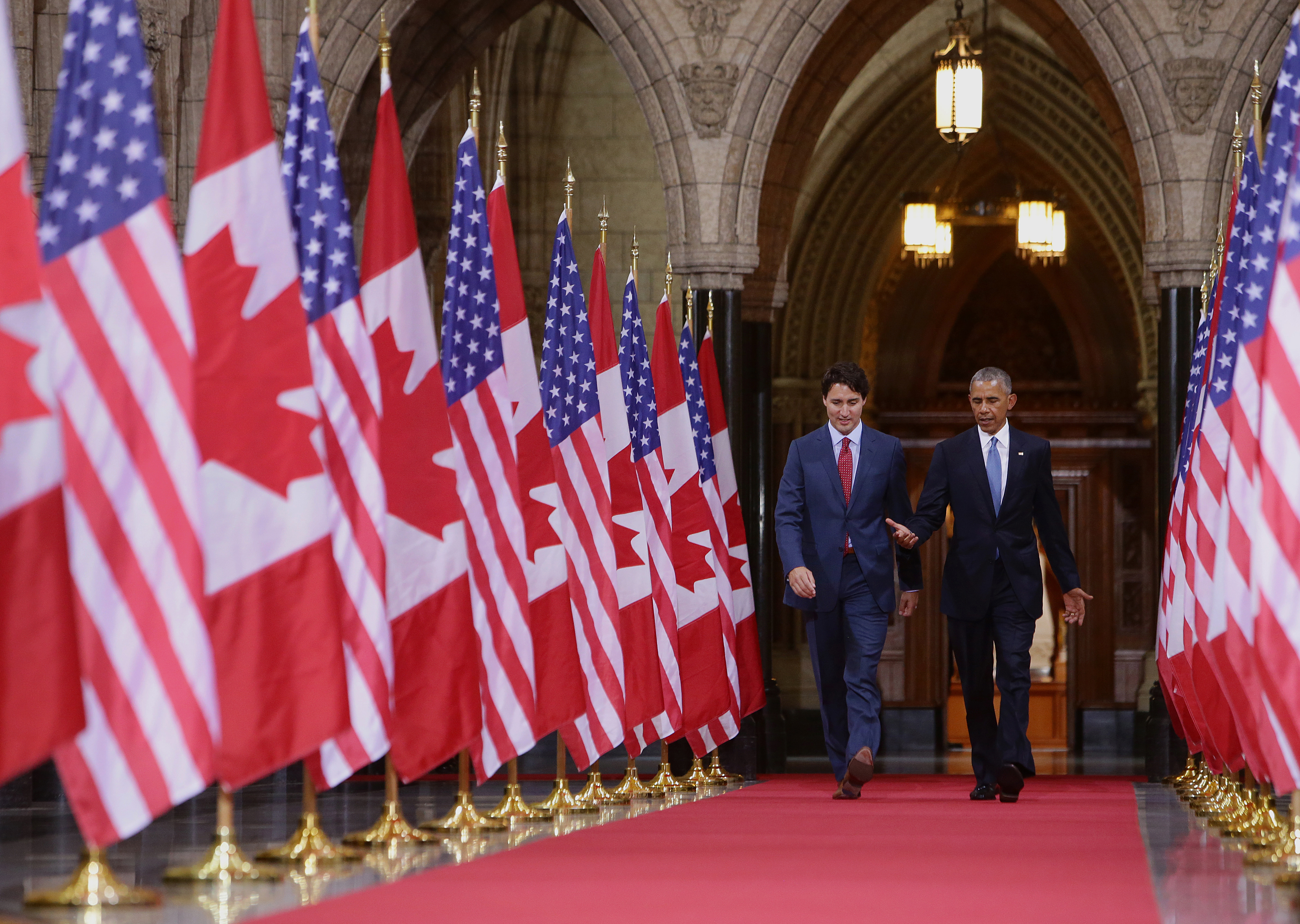 Justin Trudeau, Canada's prime minister, left, and U.S. President Barack Obama, speak as they walk inside the Hall of Honour inside Parliament Hill in Ottawa, Ontario, Canada, on Wednesday, June 29, 2016. Bloomberg—Bloomberg via Getty Images