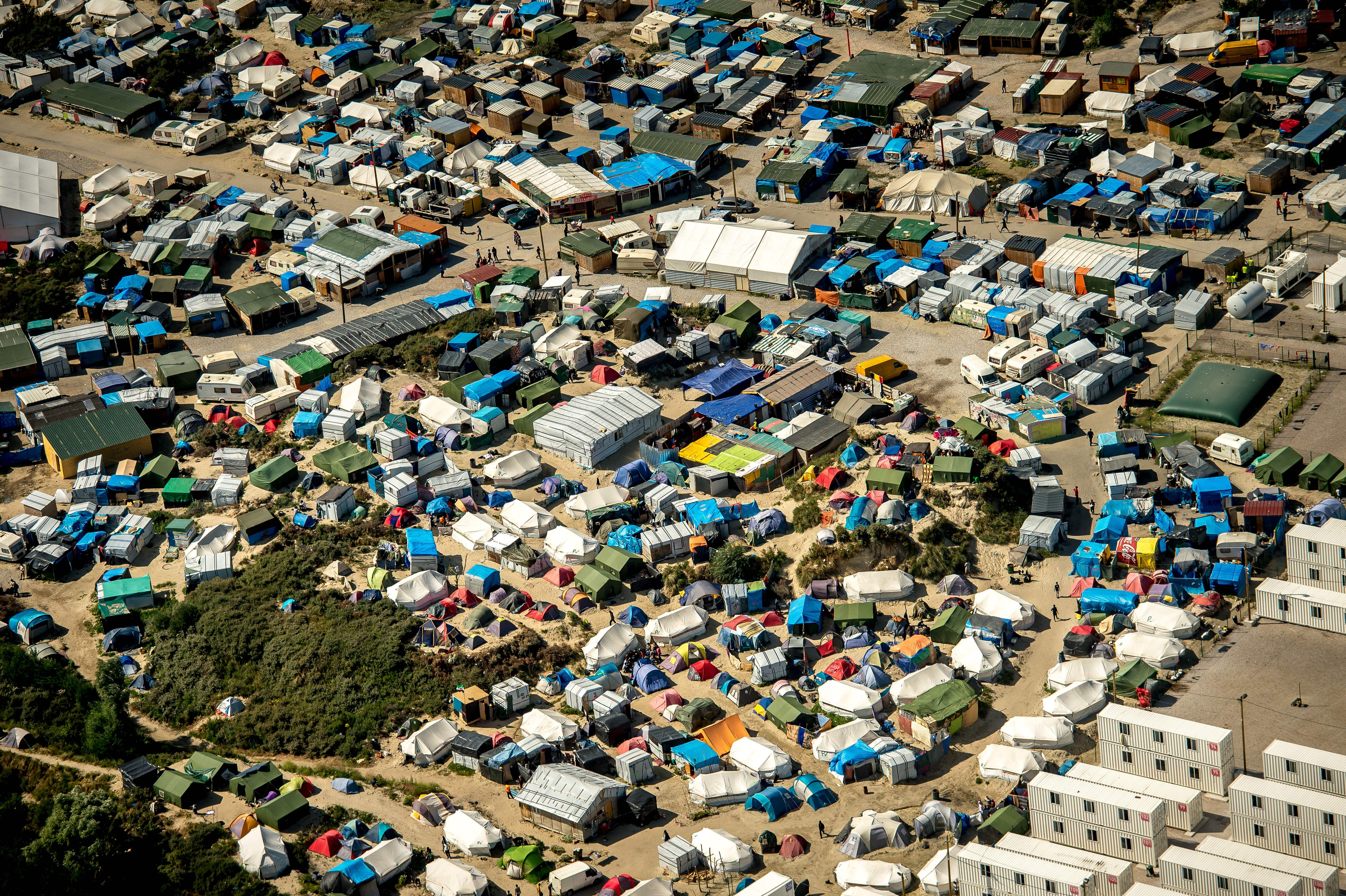 This aerial view taken on Aug. 16, 2016, in Calais, northern France shows tents of the  jungle  camp where over 9000 migrants live according to different NGOs.