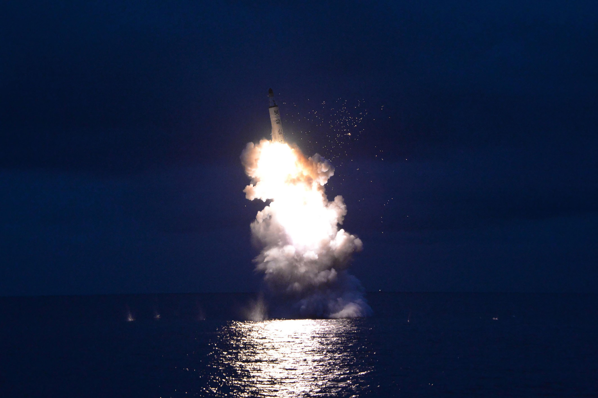 This undated picture from North Korea's official Korean Central News Agency (KCNA) on August 25, 2016 shows a test-fire of submarine-launched ballistic missile at an undisclosed location.