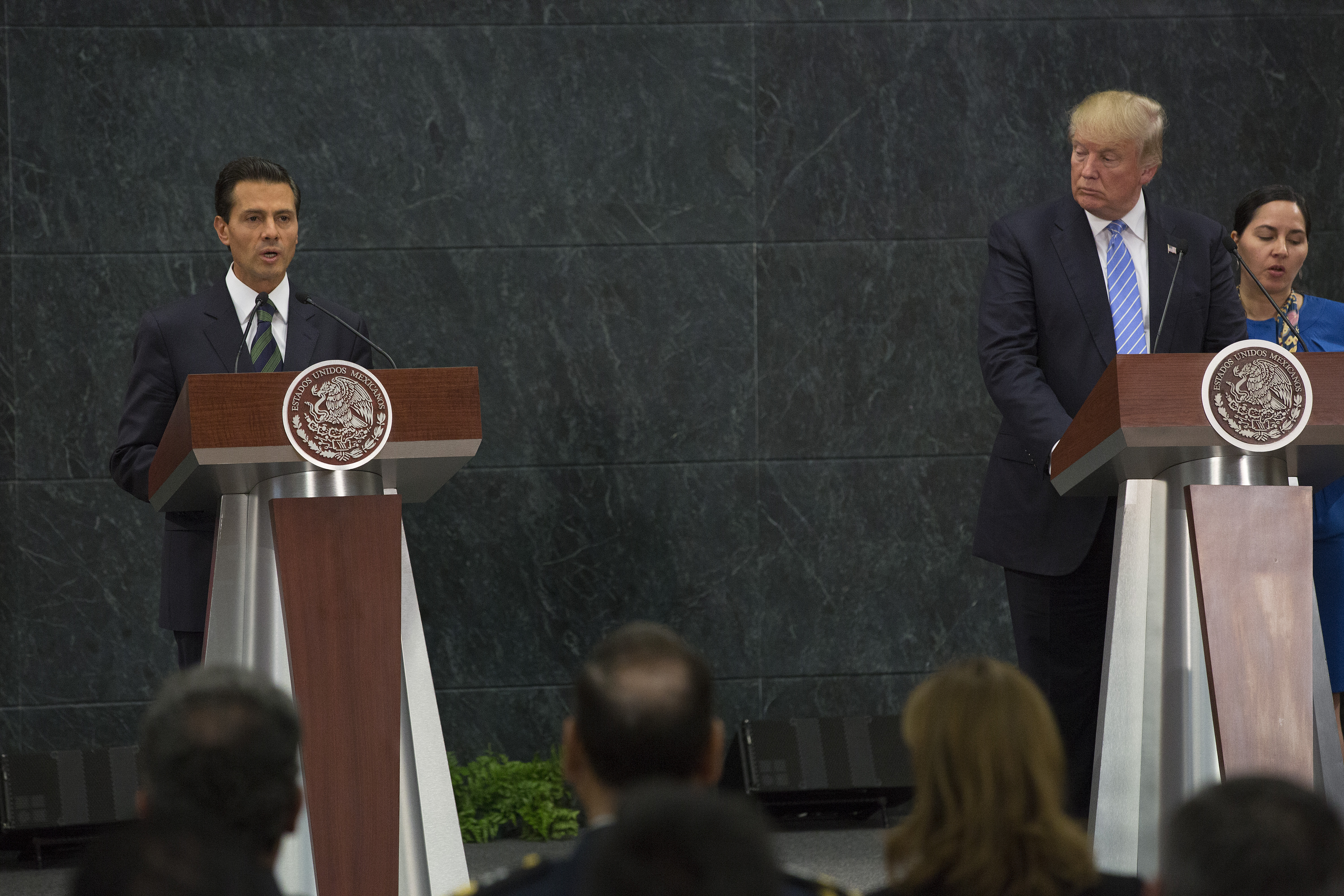 Enrique Pena Nieto, Mexico's president, left, speaks as Donald Trump, 2016 Republican presidential nominee, listens during a joint conference in Mexico City, Mexico, on Wednesday, Aug. 31, 2016. Bloomberg—Bloomberg via Getty Images