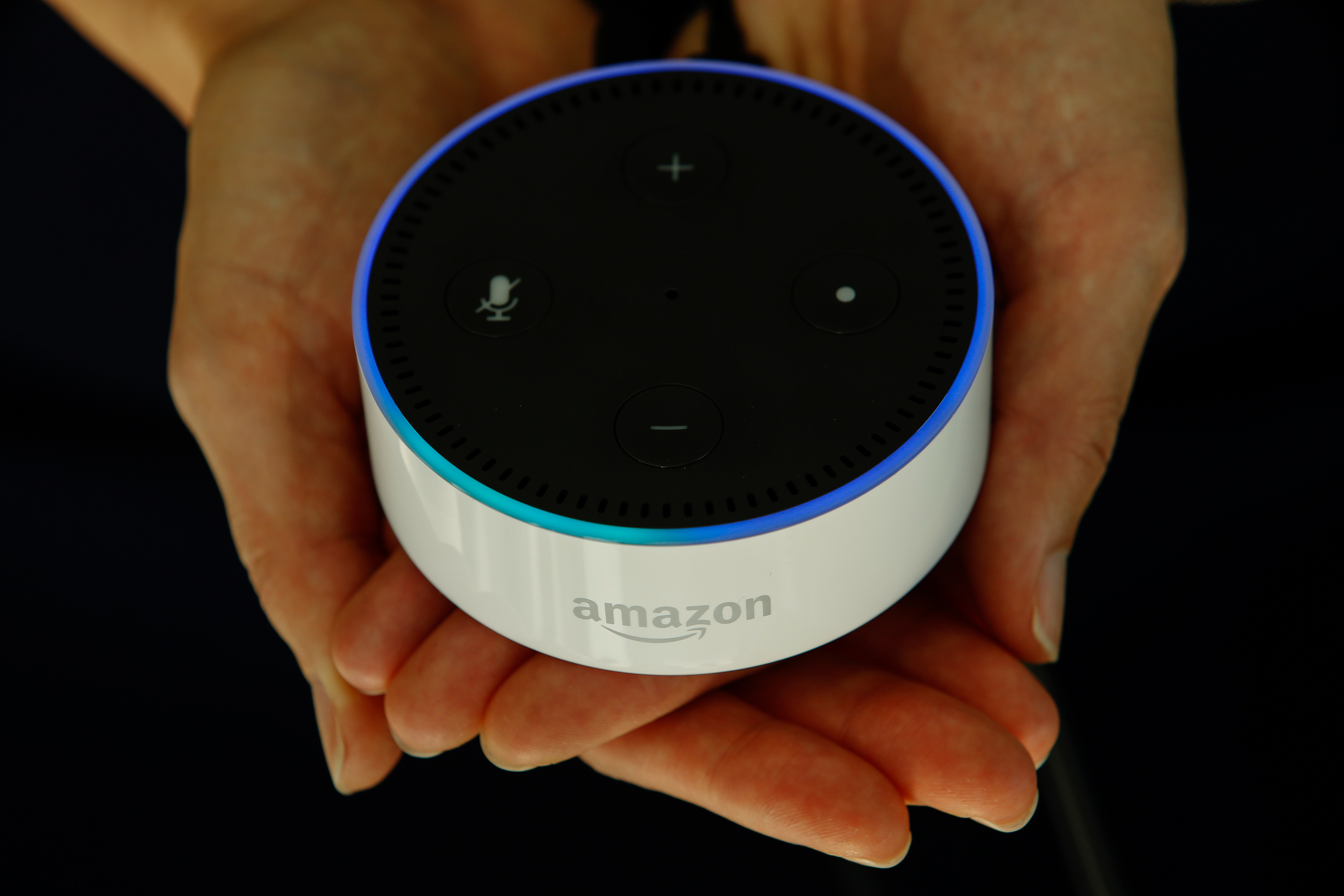 An attendee holds an  Echo Dot  device during the U.K. launch event for the Amazon.com Inc. Echo voice-controlled home assistant speaker in this arranged photograph in London, U.K., on Wednesday, Sept. 14, 2016.