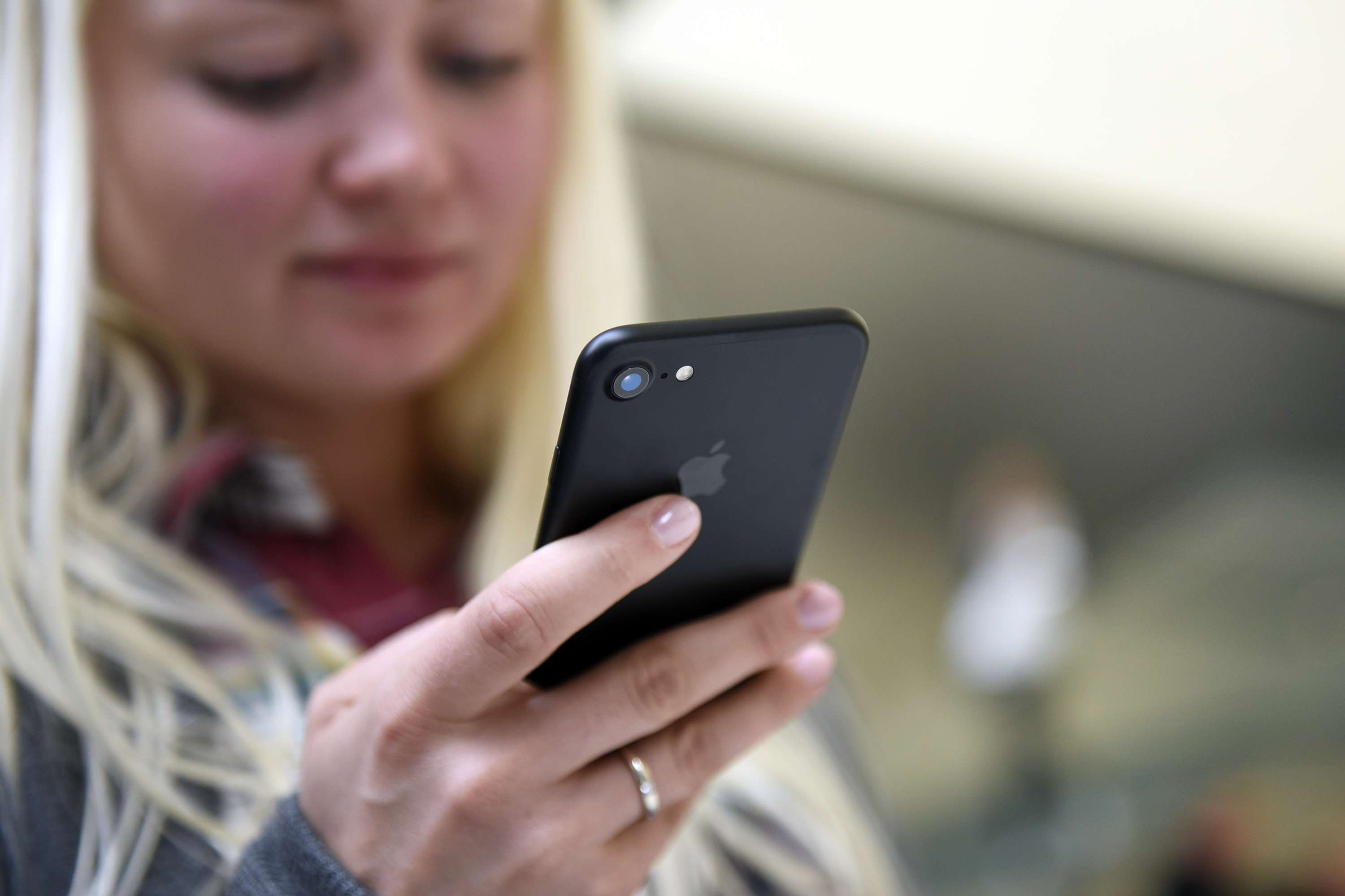 A customer views an iPhone 7 smartphone at an Apple Inc. in San Francisco, California, U.S., on Friday, Sept. 16, 2016.