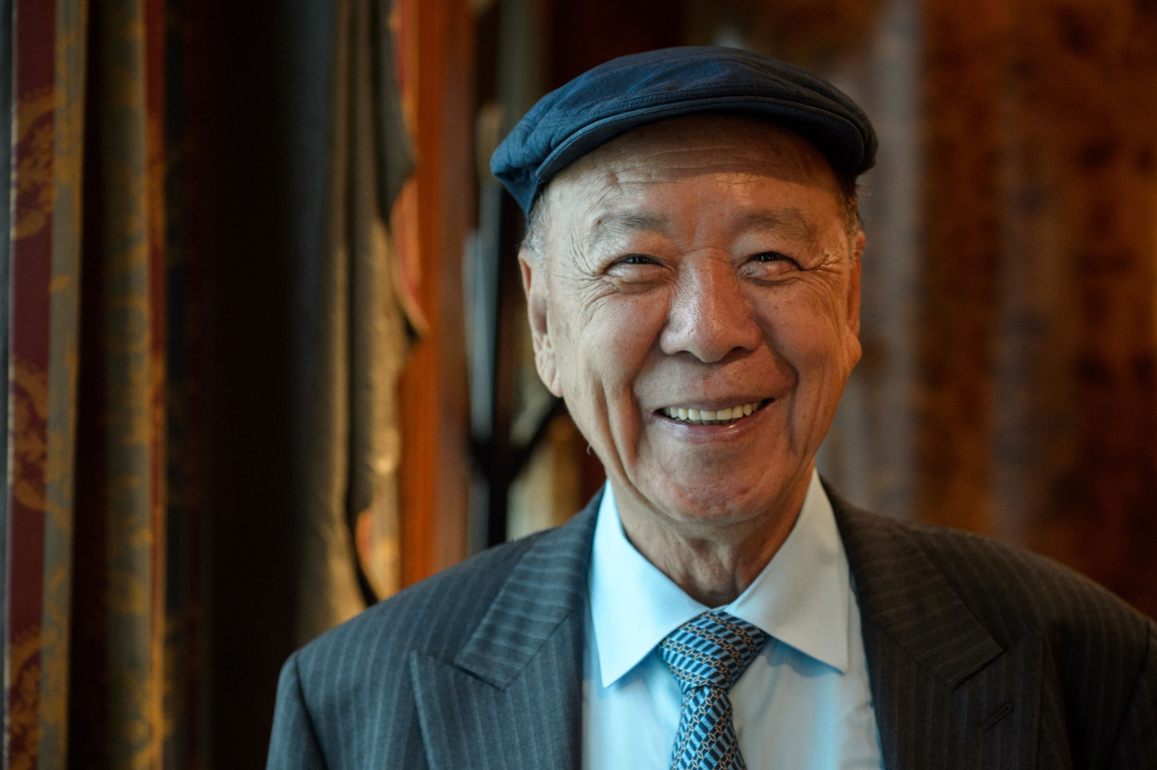 In this picture taken on Sept. 26, 2016, chairman and founder of Galaxy Entertainment Group Lui Che-woo, 87, poses during an interview with AFP in Hong Kong.
