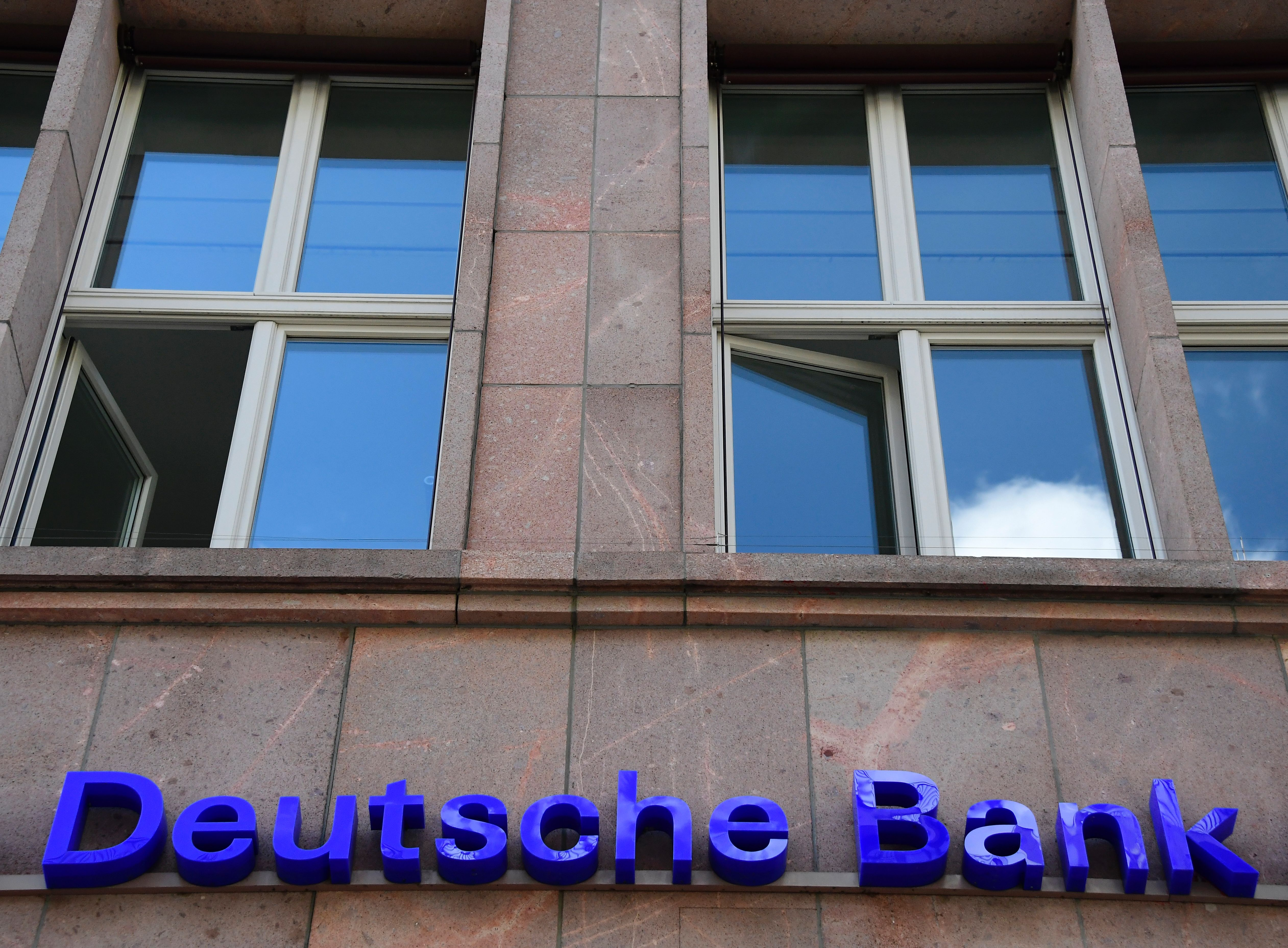 The logo of Germany's biggest lender Deutsche Bank is seen on a branch of the bank in Berlin's Mitte district on September 30, 2016.                 Shares in Deutsche Bank plummeted on the Frankfurt stock market, dragging other European banks and global markets down with it, after reports some customers were pulling money out.