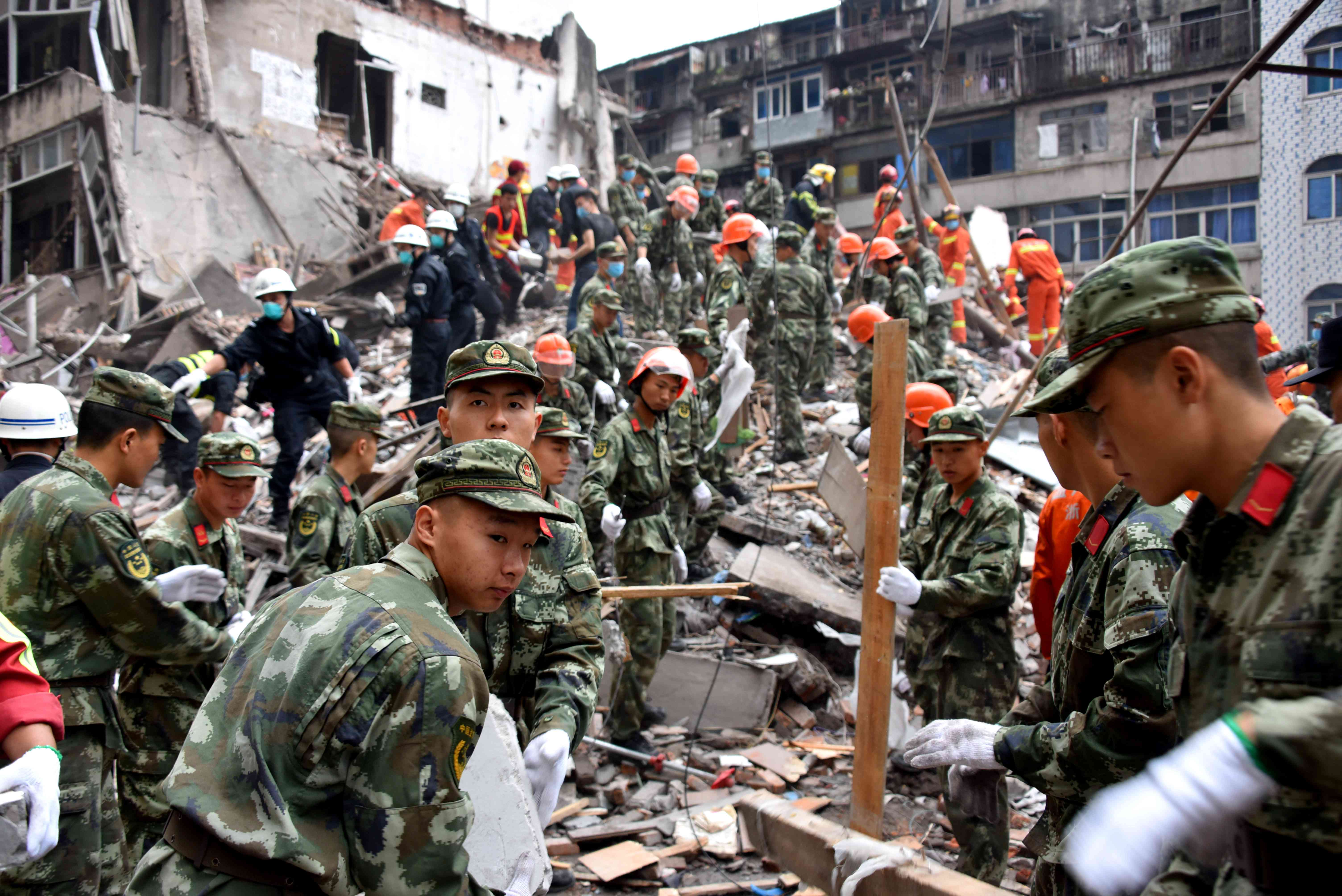 Rescuers search for survivors on the rubble of collapsed buildings on October 10, 2016 in Wenzhou, China.