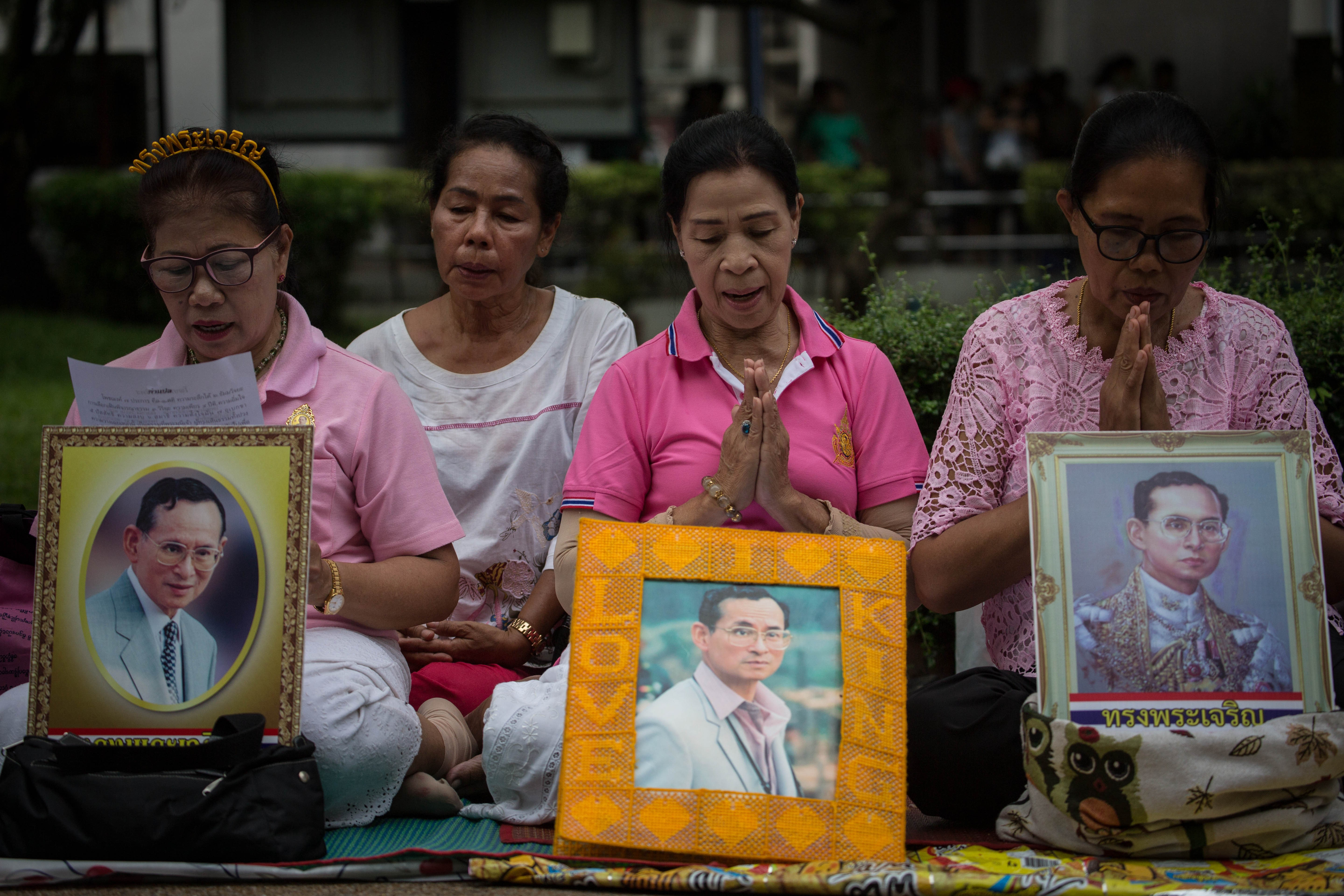 Thai Royalists holds several portraits of Thailand's King Bhumibol Adulyadej at Siriraj Hospital as his health has deteriorated and he's now in an unstable condition under medical ventilator said the Thai Palace in Bangkok on Oct. 12, 2016.