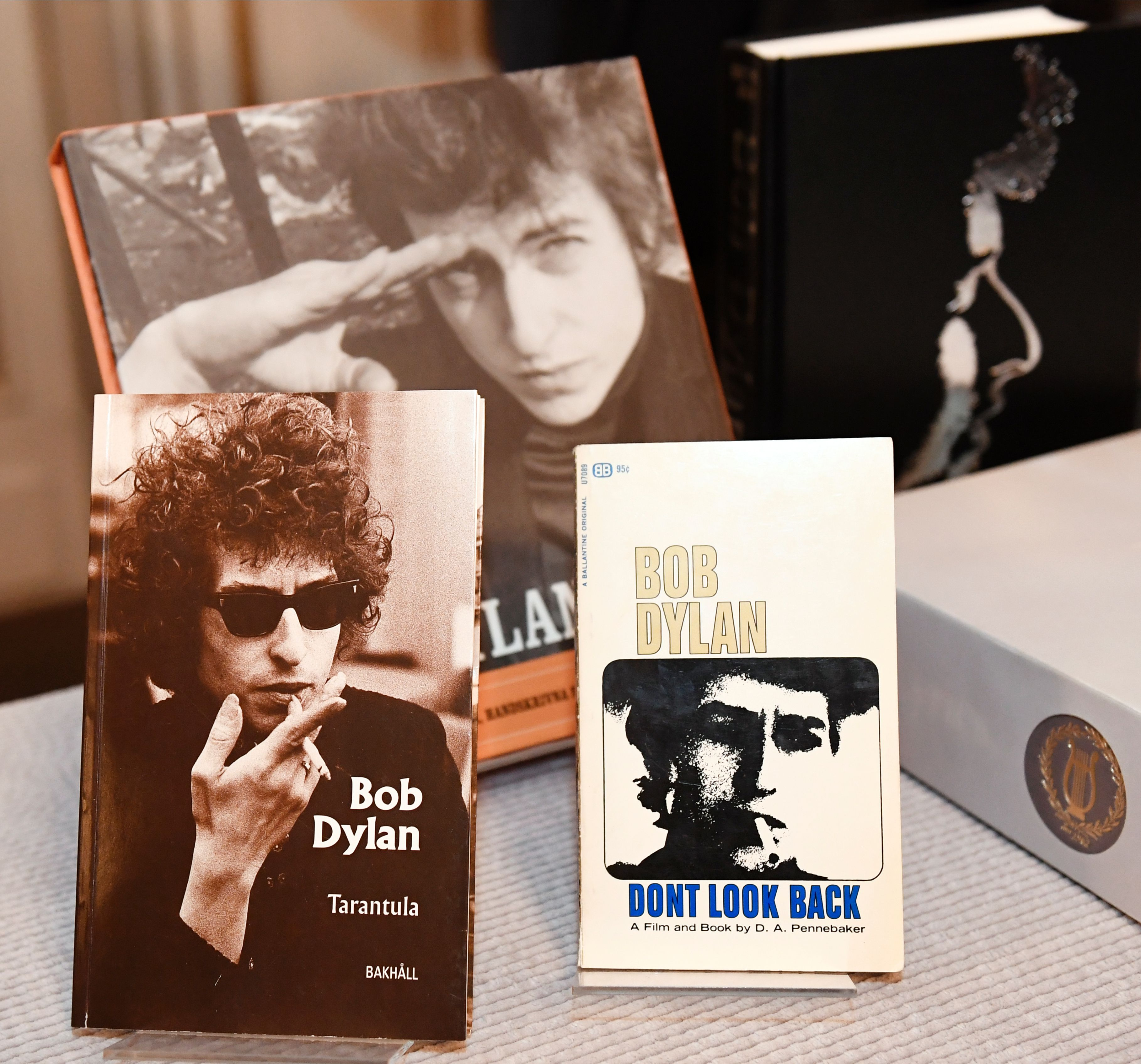 Books by and about US songwriter Bob Dylan who was announced the laureate of the 2016 Nobel Prize in Literature are displayed at the Swedish Academy in Stockholm, Sweden, on Oct. 13, 2016.