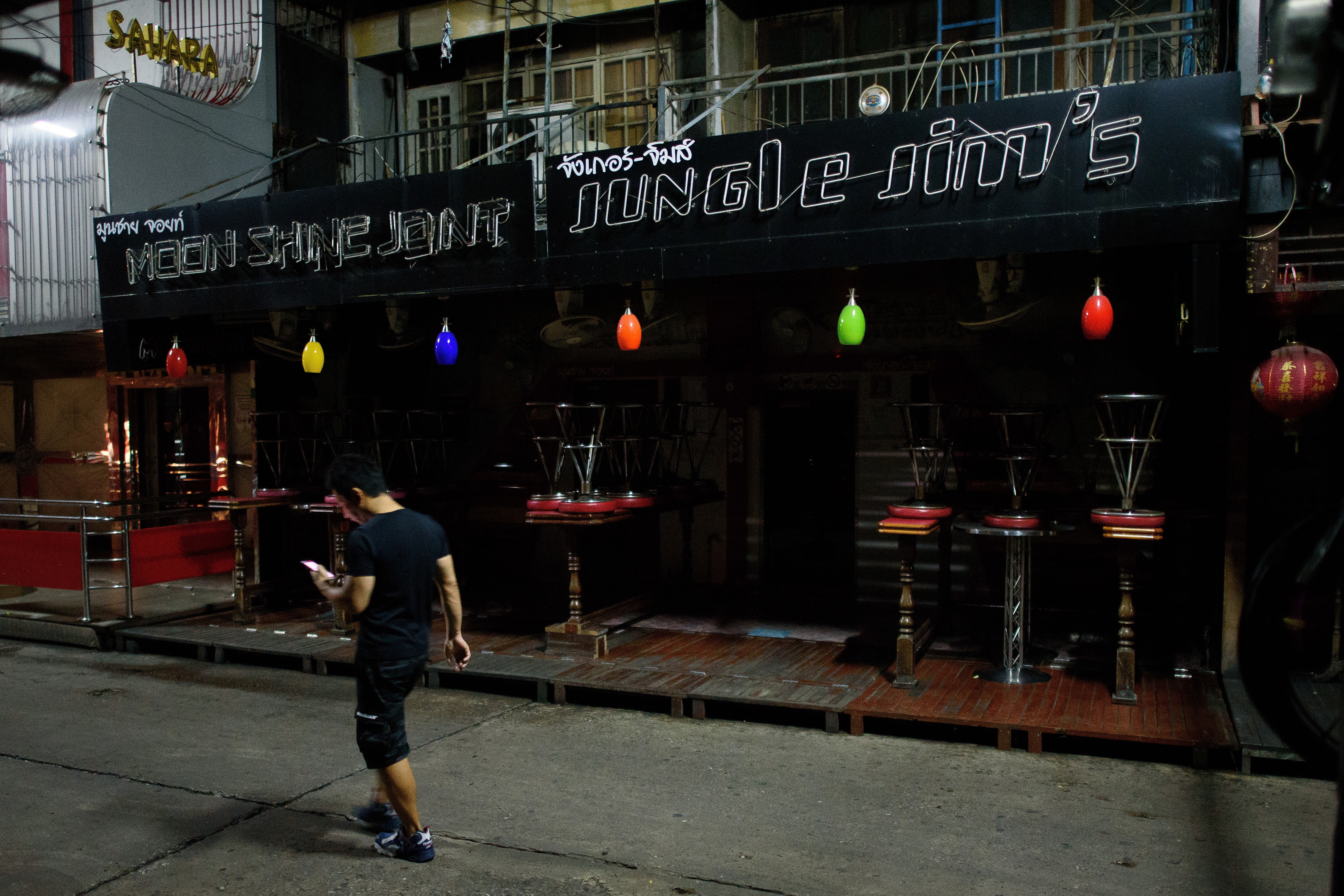 The clubs and bars of the adult entertainment district Soi Cowboy remain shuttered and silent as the country continues to mourn the loss of its King on Oct. 16, 2016, in Bangkok