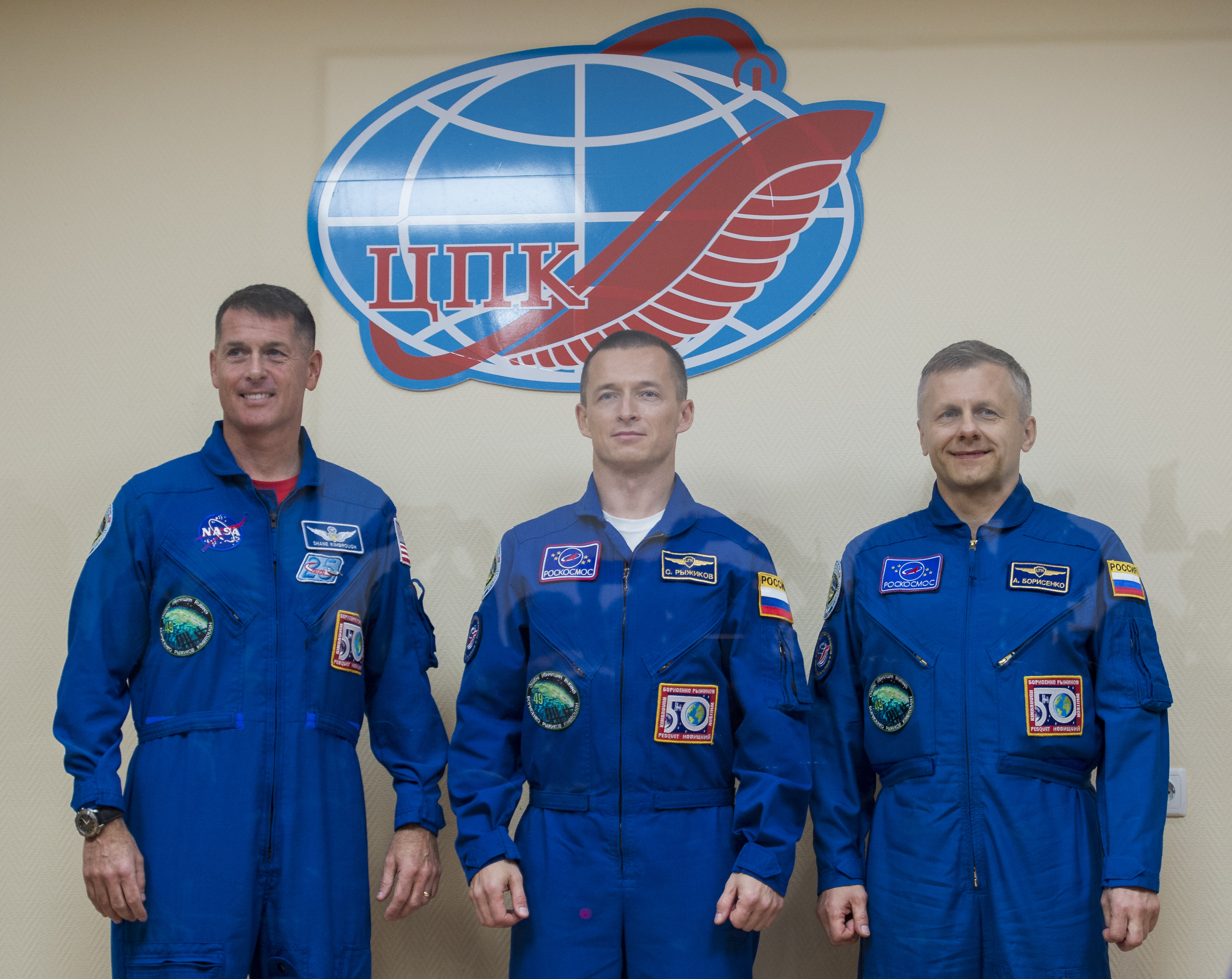 BAIKNOR, KAZAKHSTAN - OCTOBER 18: (L-R) Expedition 49 flight engineer Shane Kimbrough of NASA, Soyuz commander Sergey Ryzhikov of Roscosmos, and flight engineer Andrey Borisenko of Roscosmos, pose for a picture at the conclusion of a crew press conference at the Cosmonaut Hotel on October 18, 2016  in Baikonur, Kazakhstan.  Kimbrough, Ryzhikov, and Borisenko are scheduled to launch to the International Space Station aboard the Soyuz MS-02 spacecraft from the Baikonur Cosmodrome on October 19.  (Photo by NASA/Joel Kowsky via Getty Images)