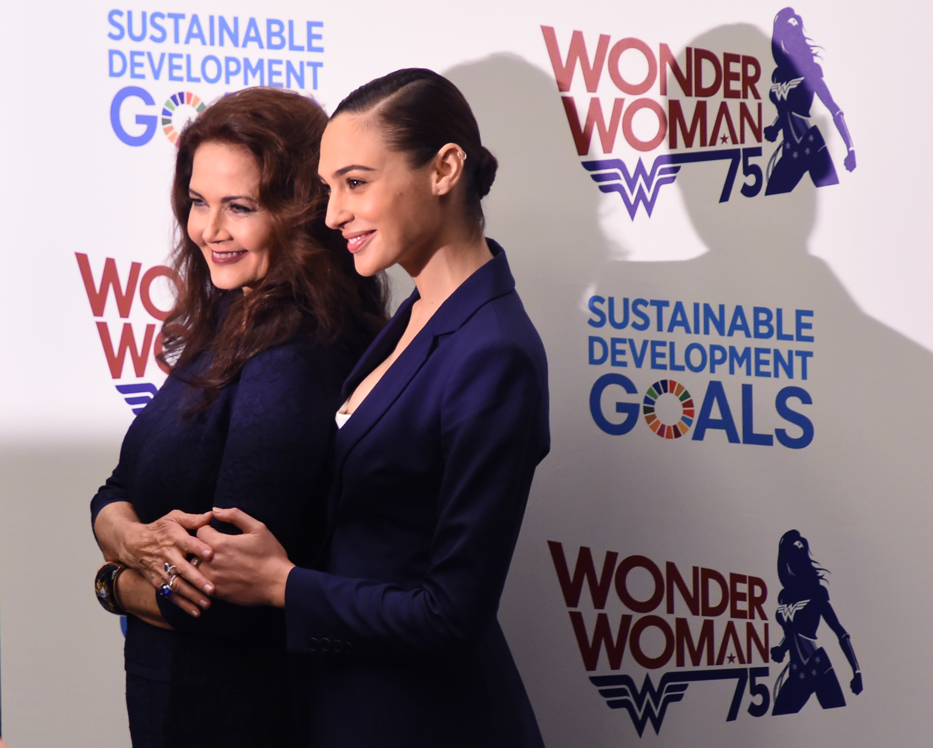 Actors Gal Gadot (R) and Lynda Carter pose as the UN names the comic character Wonder Woman its Honorary Ambassador for the Empowerment of Women and Girls during a ceremony at the United Nations Economic and Social Council Chamber on October 21, 2016, in New York.