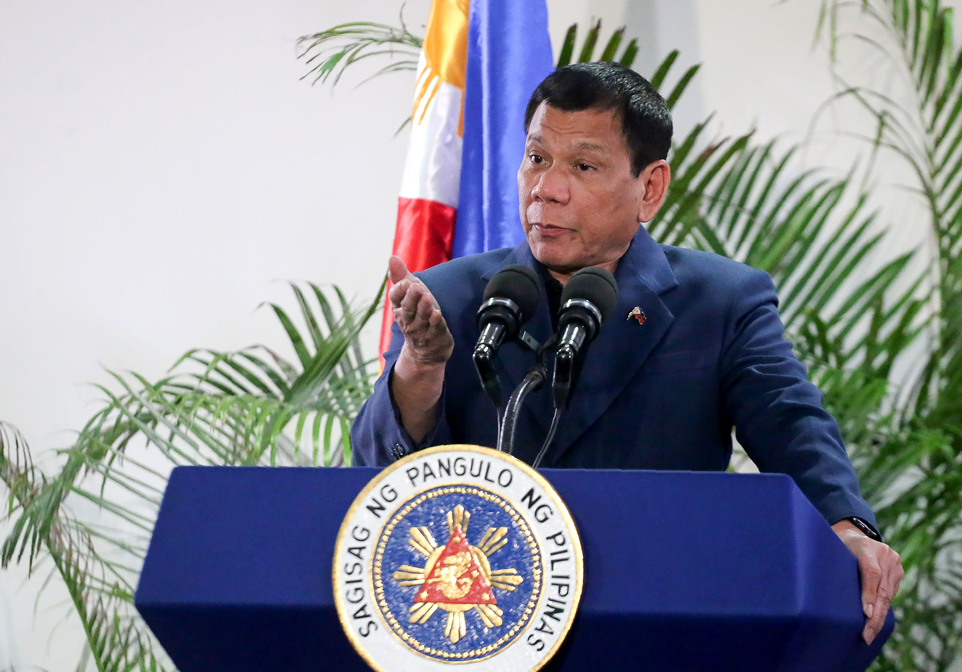 Philippine President Rodrigo Duterte speaks at the Davao International Airport in the Philippine city of Davao after returning from a state visit to Brunei and China on Oct. 22, 2016