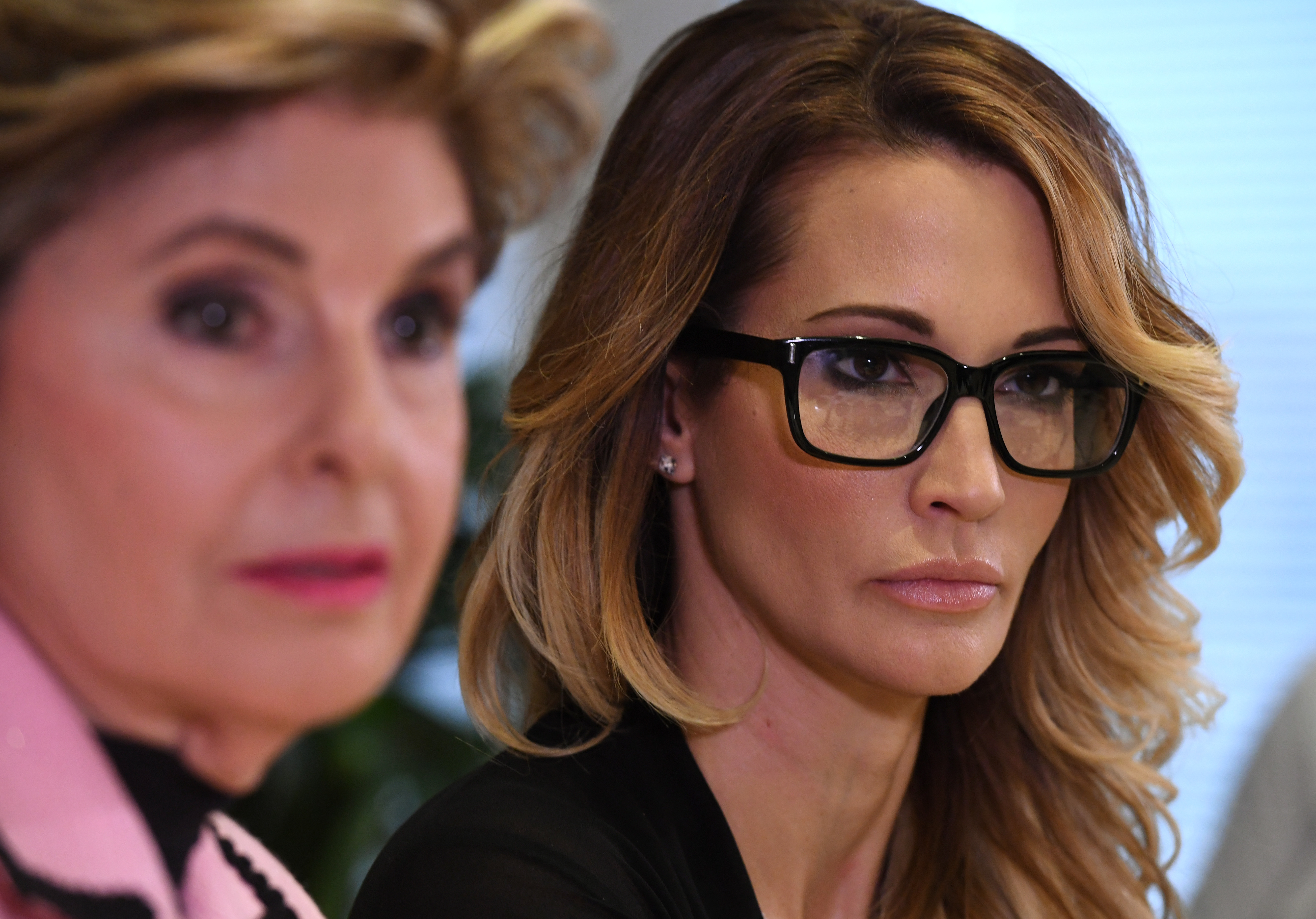Jessica Drake (R), who works for an adult film company, speaks beside attorney Gloria Allred about allegations of sexual misconduct against Republican presidential hopeful Donald Trump during a press conference in Los Angeles on October 22, 2016.  / AFP / Mark RALSTON        (Photo credit should read MARK RALSTON/AFP/Getty Images)