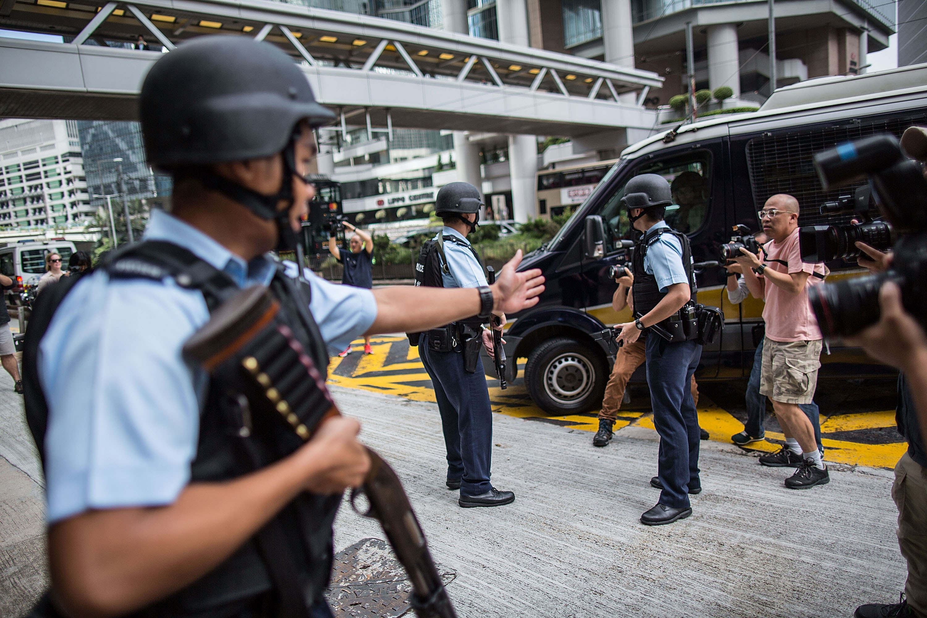 Police officers stand guard at High Court during the arrival of former British banker Rurik Jutting on Oct. 24, 2016, in Hong Kong