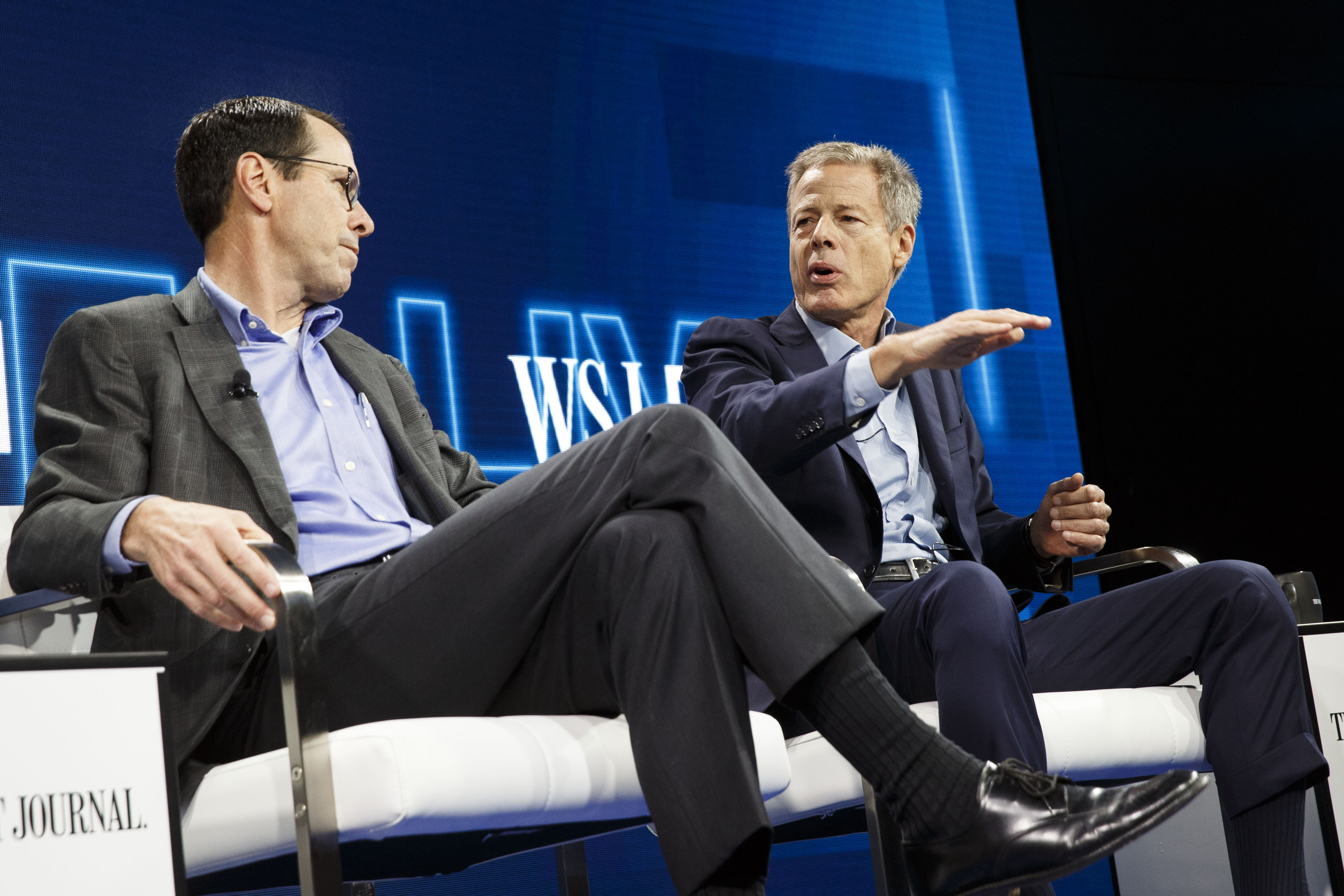 Randall Stephenson, chairman and chief executive officer of AT&T Inc., left, listens while Jeffrey  Jeff  Bewkes, chairman and chief executive officer of Time Warner Inc., speaks during the WSJDLive Global Technology Conference in Laguna Beach, California, U.S., on Tuesday, Oct. 25, 2016.