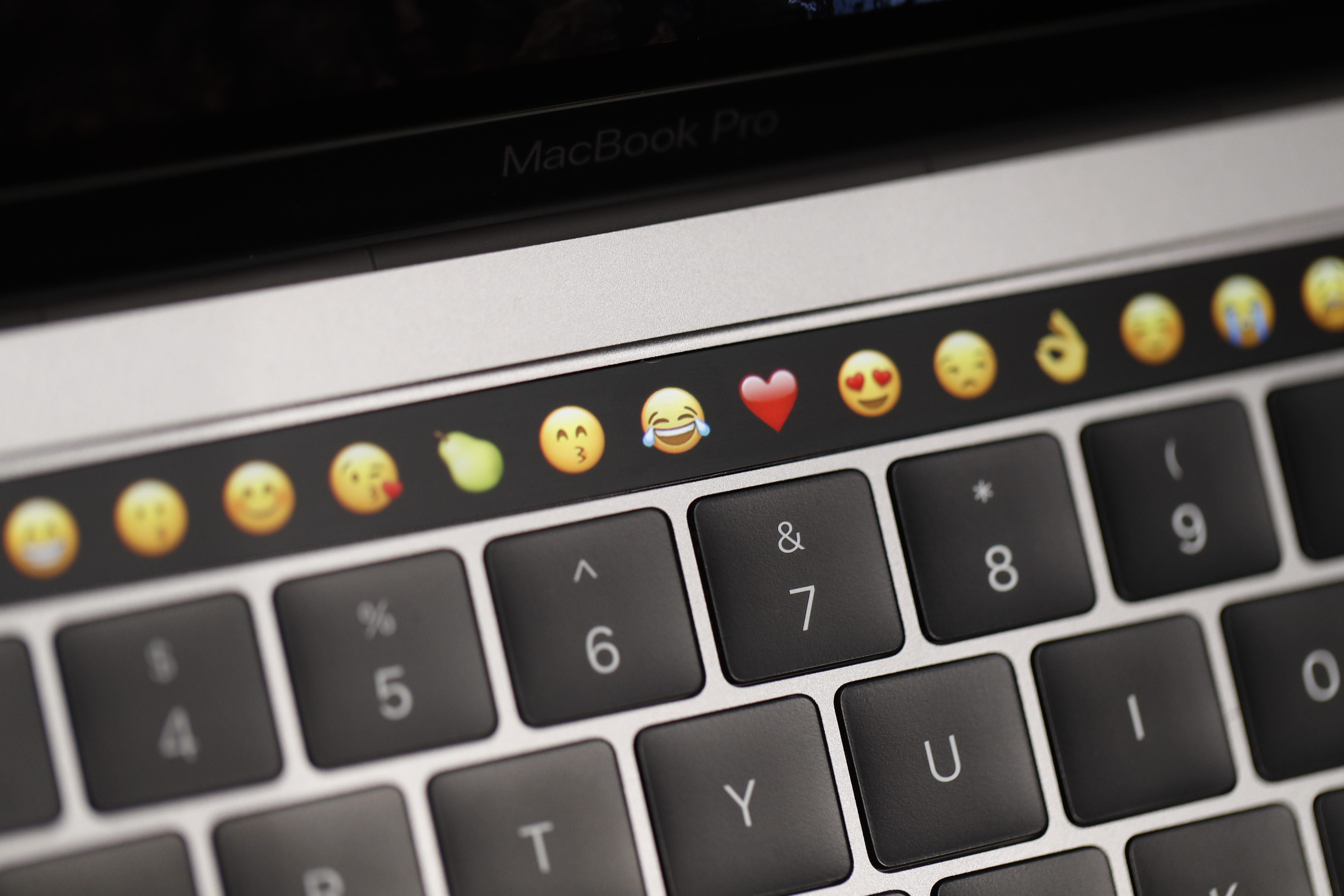 Emoticons are displayed on the Touch Bar on a new Apple MacBook Pro laptop during a product launch event on October 27, 2016 in Cupertino, California.