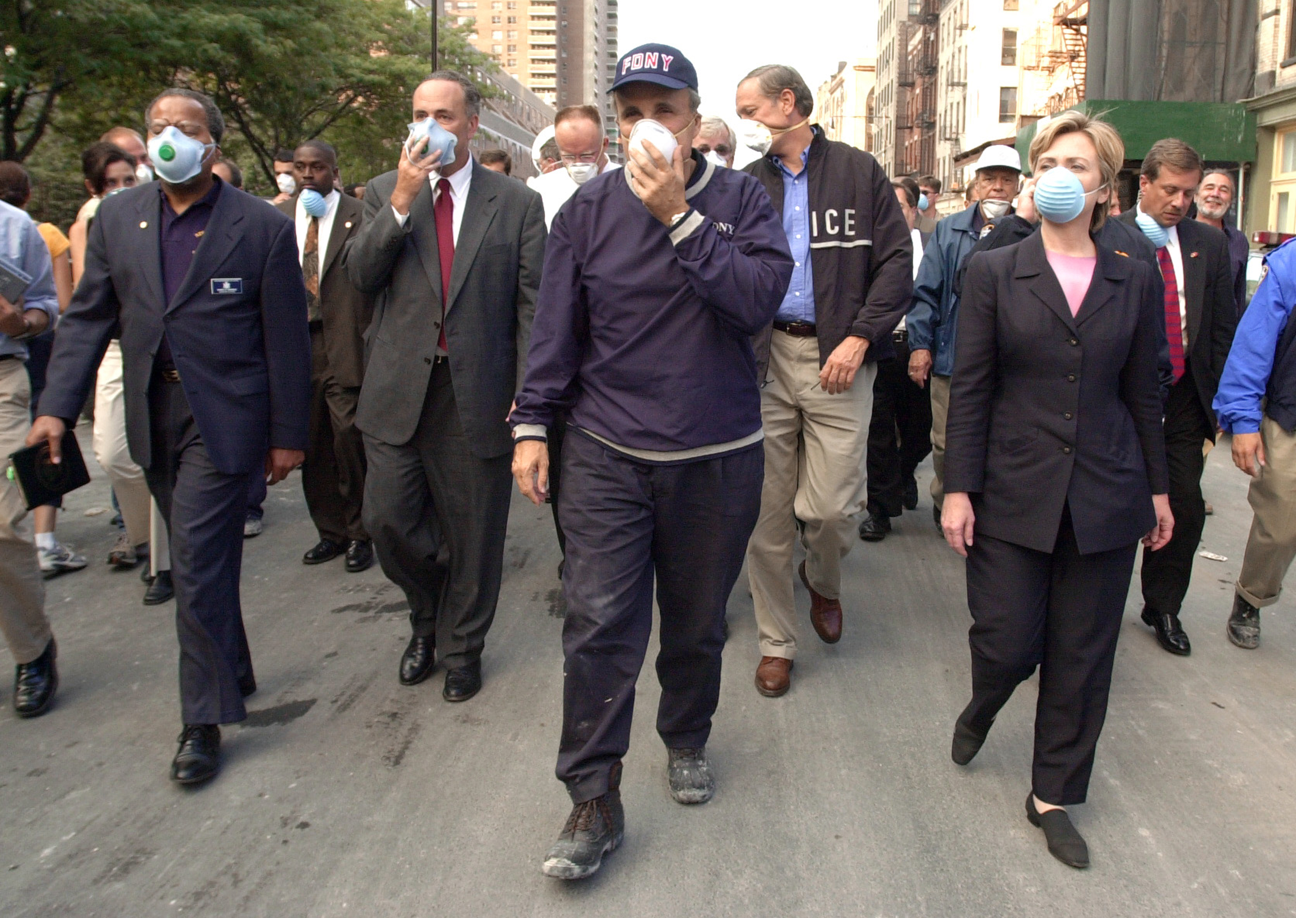 New York City Mayor Rudolph Giuliani (center) leads US Senator Charles Schumer, R-NY (second from left), New York Governor George Pataki (second from right) and US Senator Hillary Rodham Clinton, D-NY (right), on a tour of the site of the World Trade Center disaster in New York on Sept. 12, 2001.
