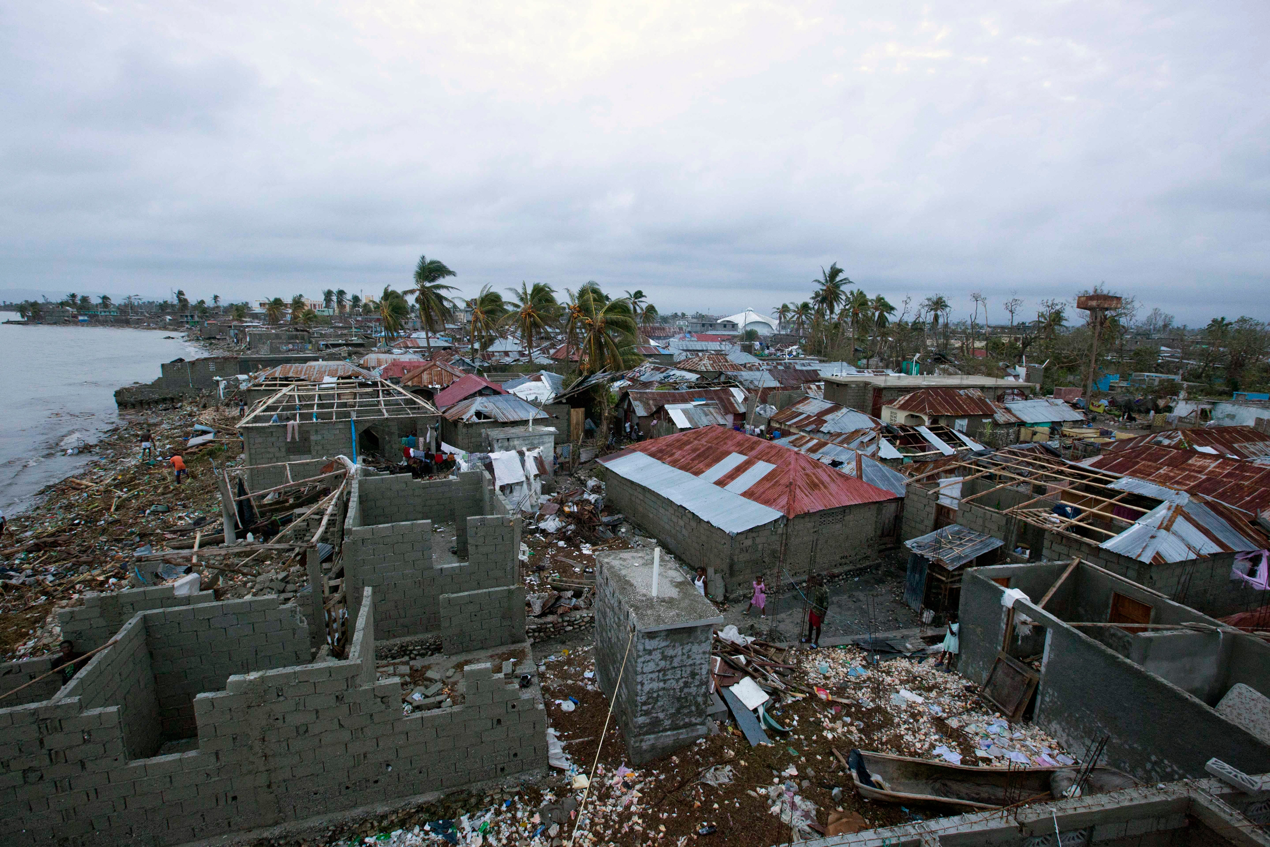 Homes lay in ruins after the passing of Hurricane Matthew in Les Cayes, Haiti, on Oct. 6, 2016.